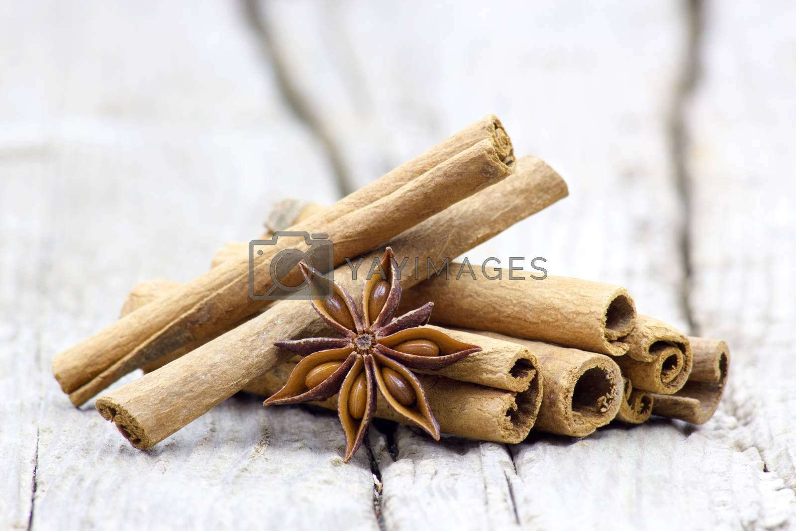 cinnamon sticks and anise on wooden background