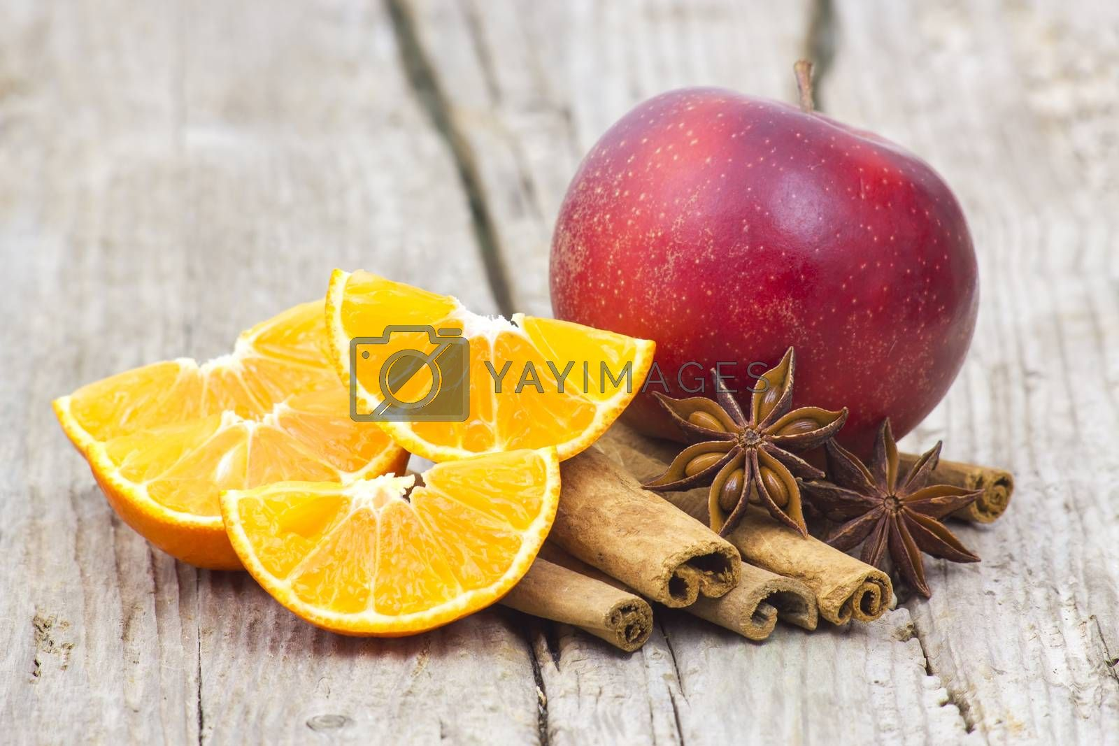 fruits and spises on wooden background