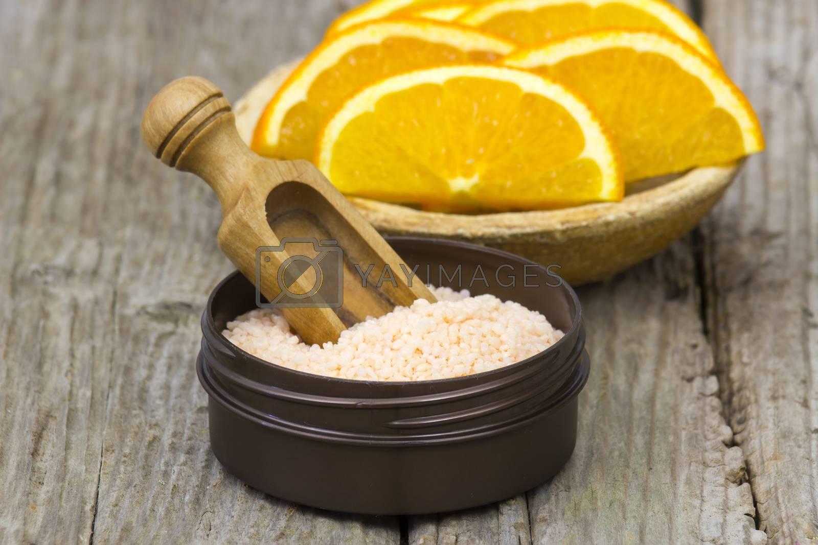 orange bath salt and fresh fruits - beauty treatment