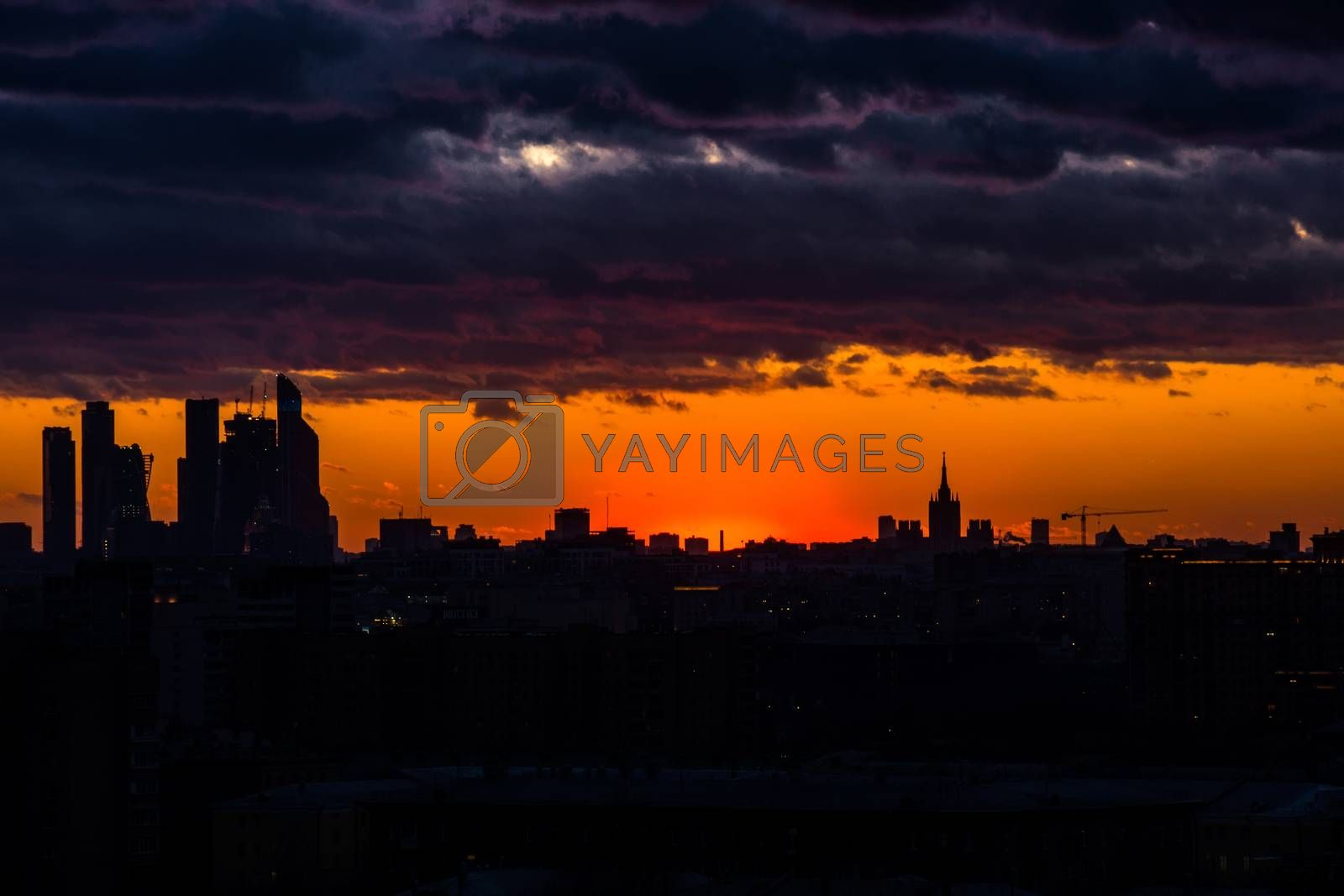 The photo depicts the silhouette of the city