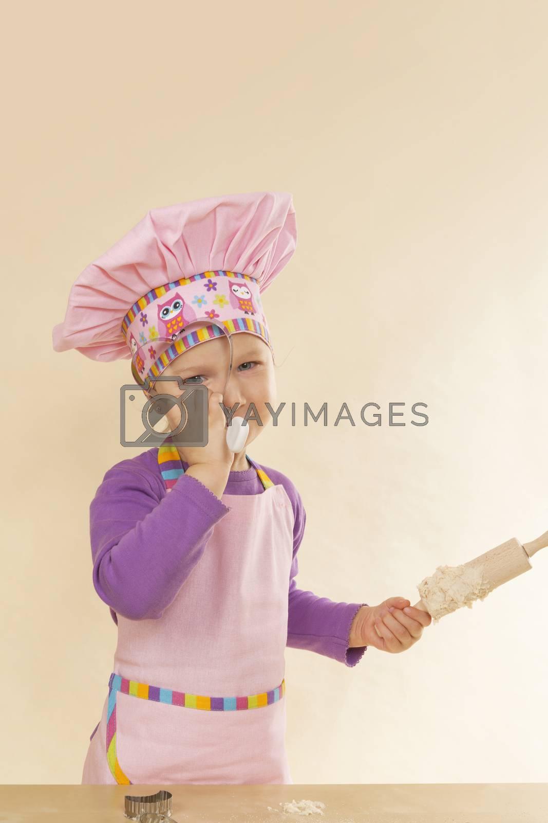 Cute little girl baking.