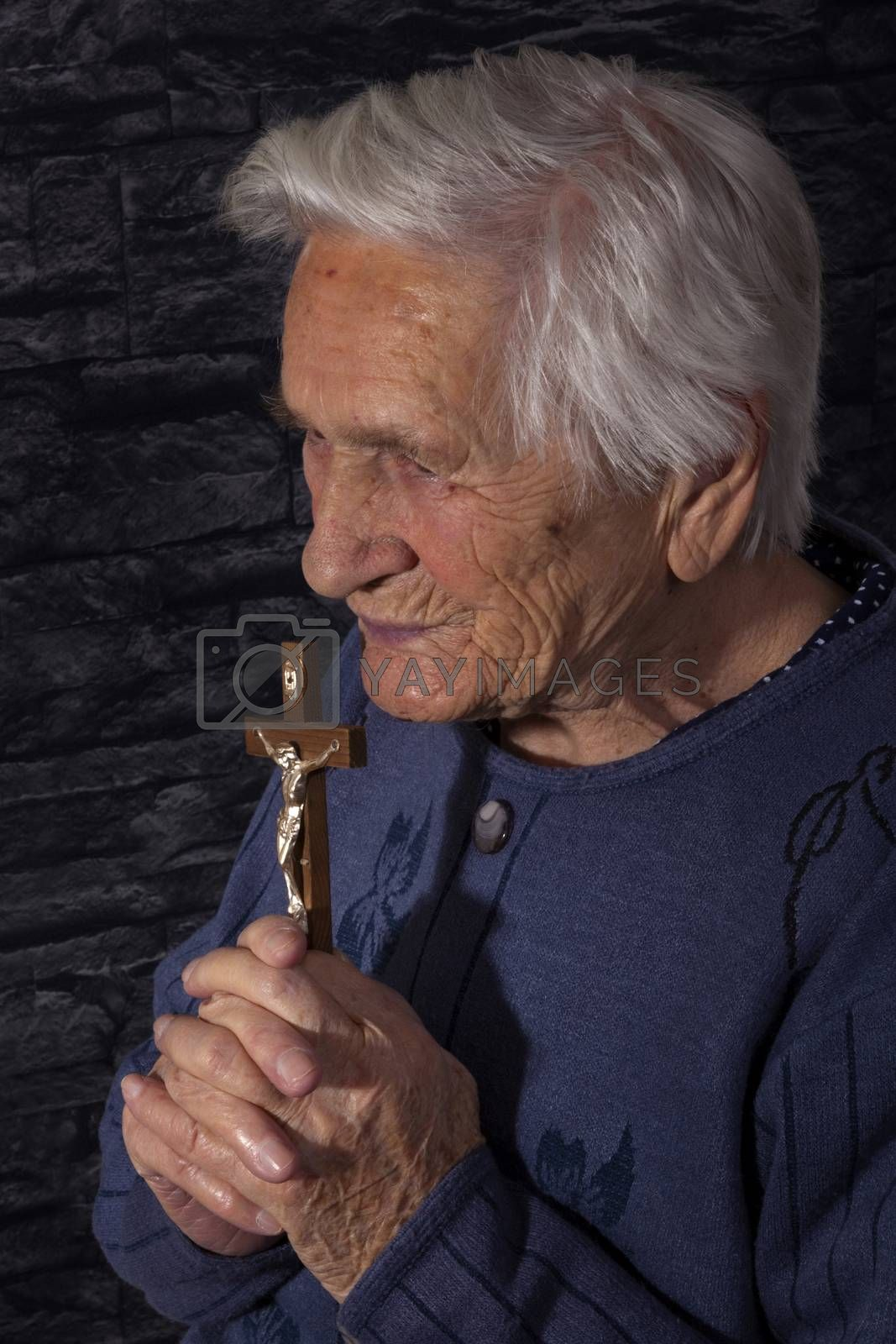 Grandmother praying. by eskymaks