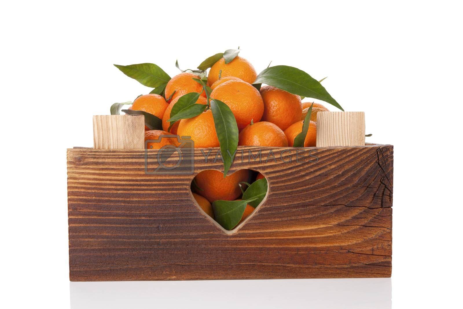 Fresh ripe mandarines in wooden crate. by eskymaks