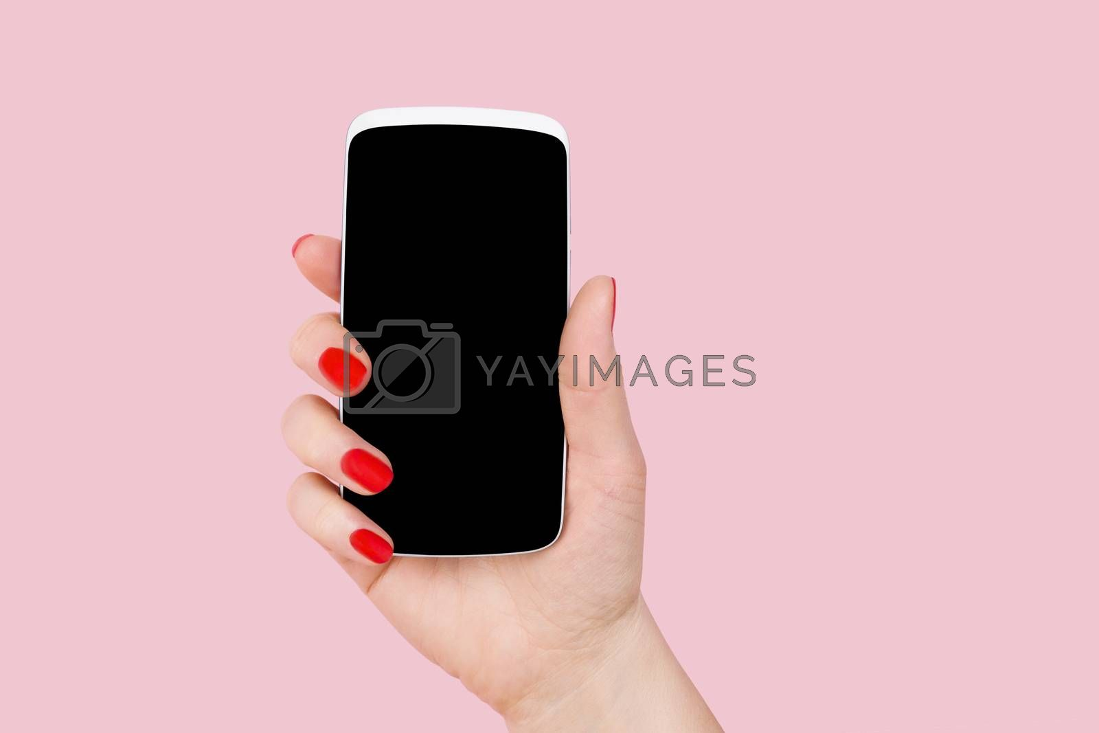 Smartphone. Female hand holding smartphone in hand. Woman and technology, feminine technology.
