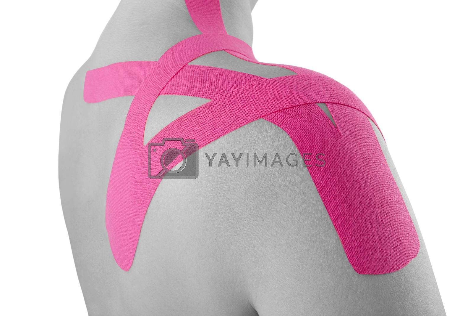 Kinesio tape on female shoulder isolated on white background. Rehabilitation and physiotherapy.