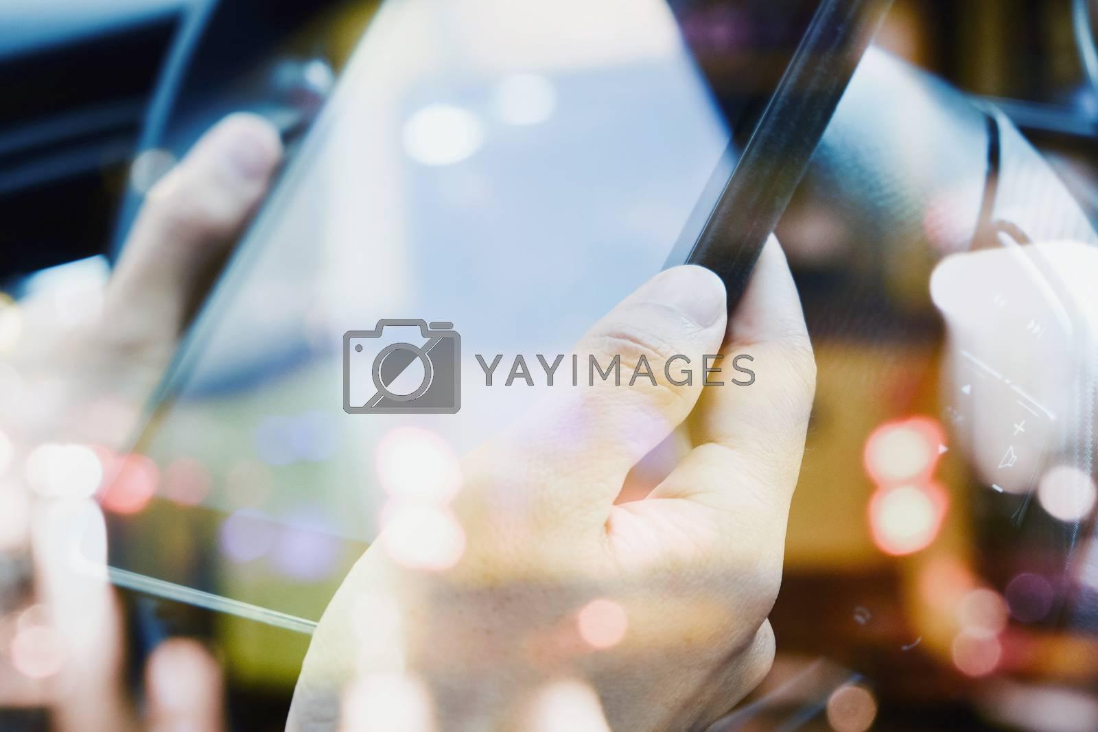 using a digital tablet inside of a car.communication technology
