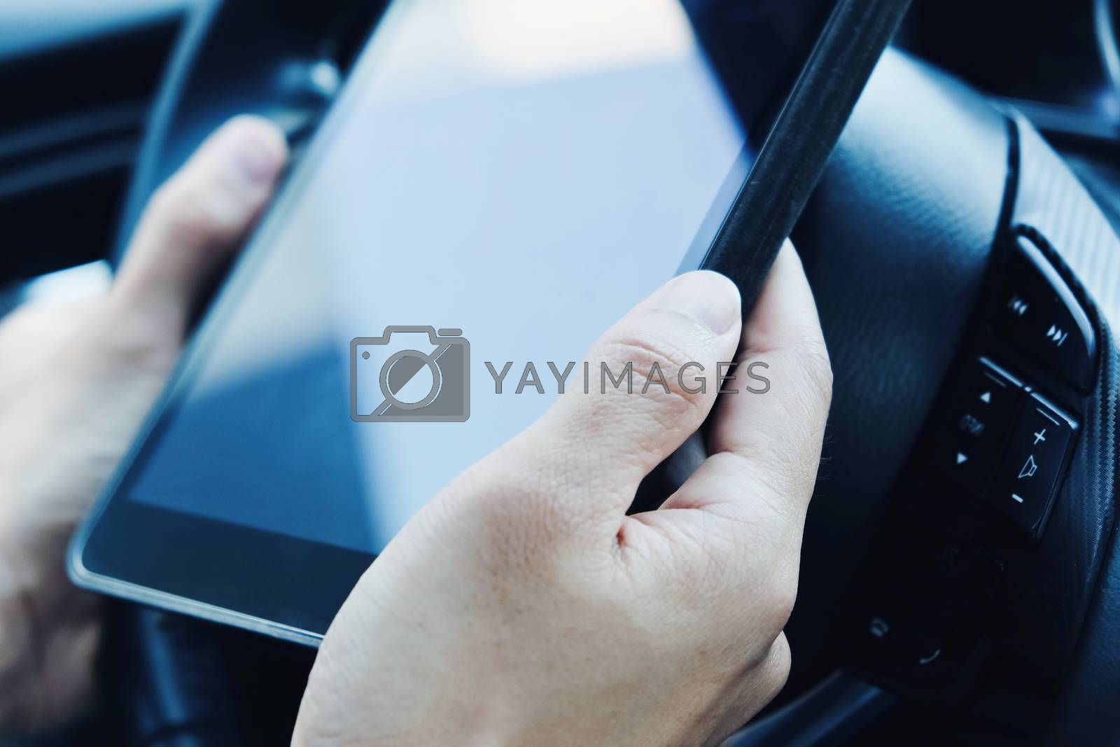 using a digital tablet inside of a car.communication technology