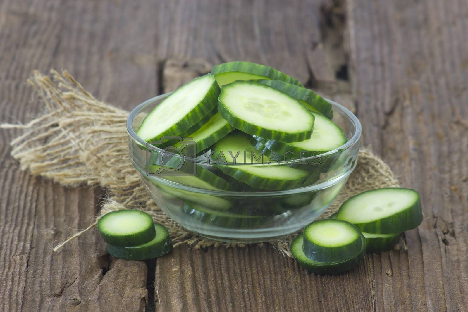 fresh sliced cucumbers on an old wooden table