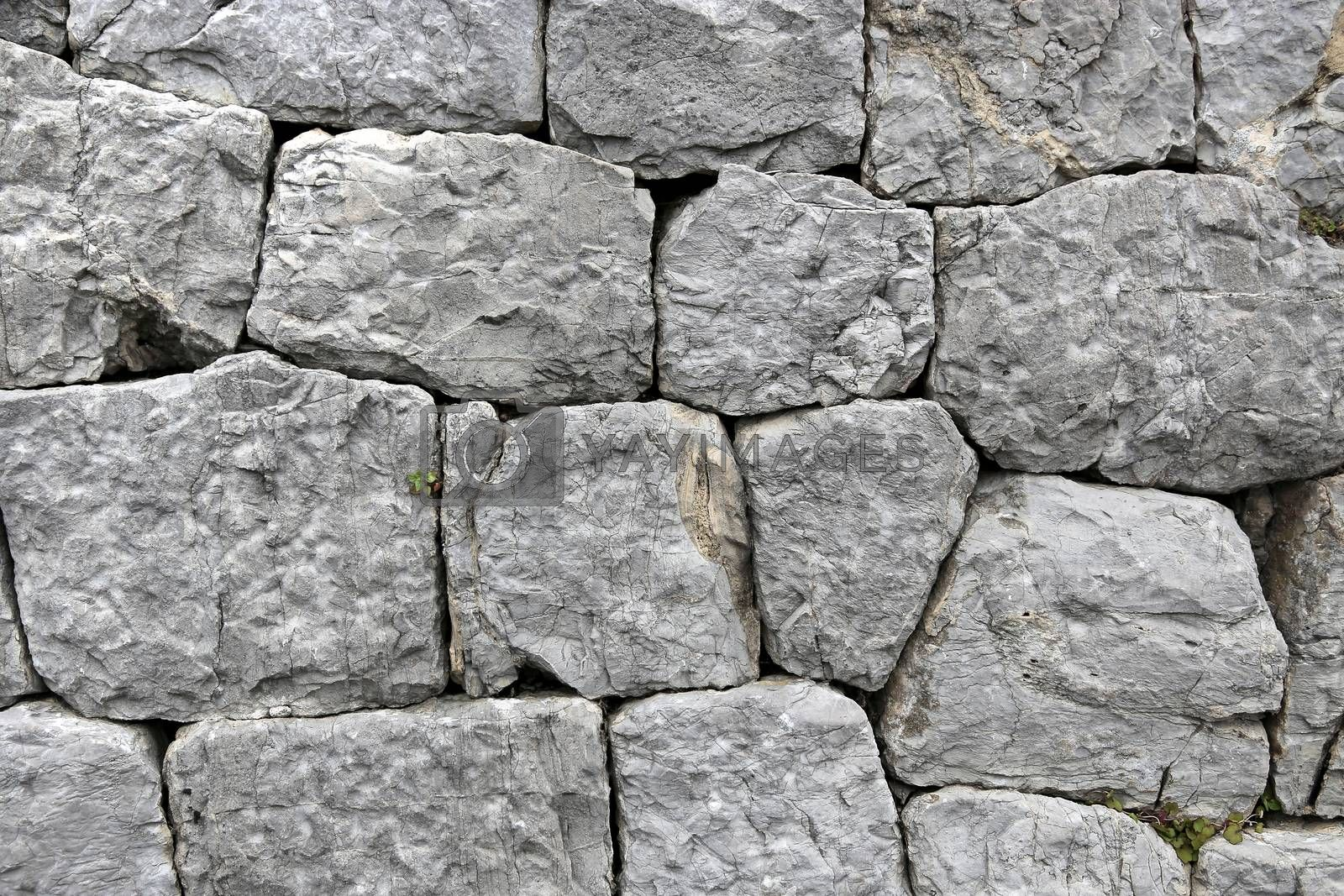 Ancient  stone wall background closeup
