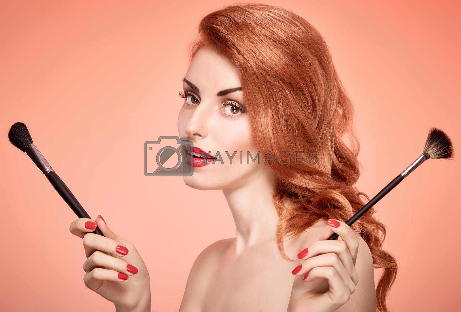 Beauty portrait nude woman smiling, eyelashes, perfect skin, red lips, fashion.Gorgeous sensual attractive pretty redhead sexy model girl with makeup brushes on pink, shiny wavy hair.People, copyspace