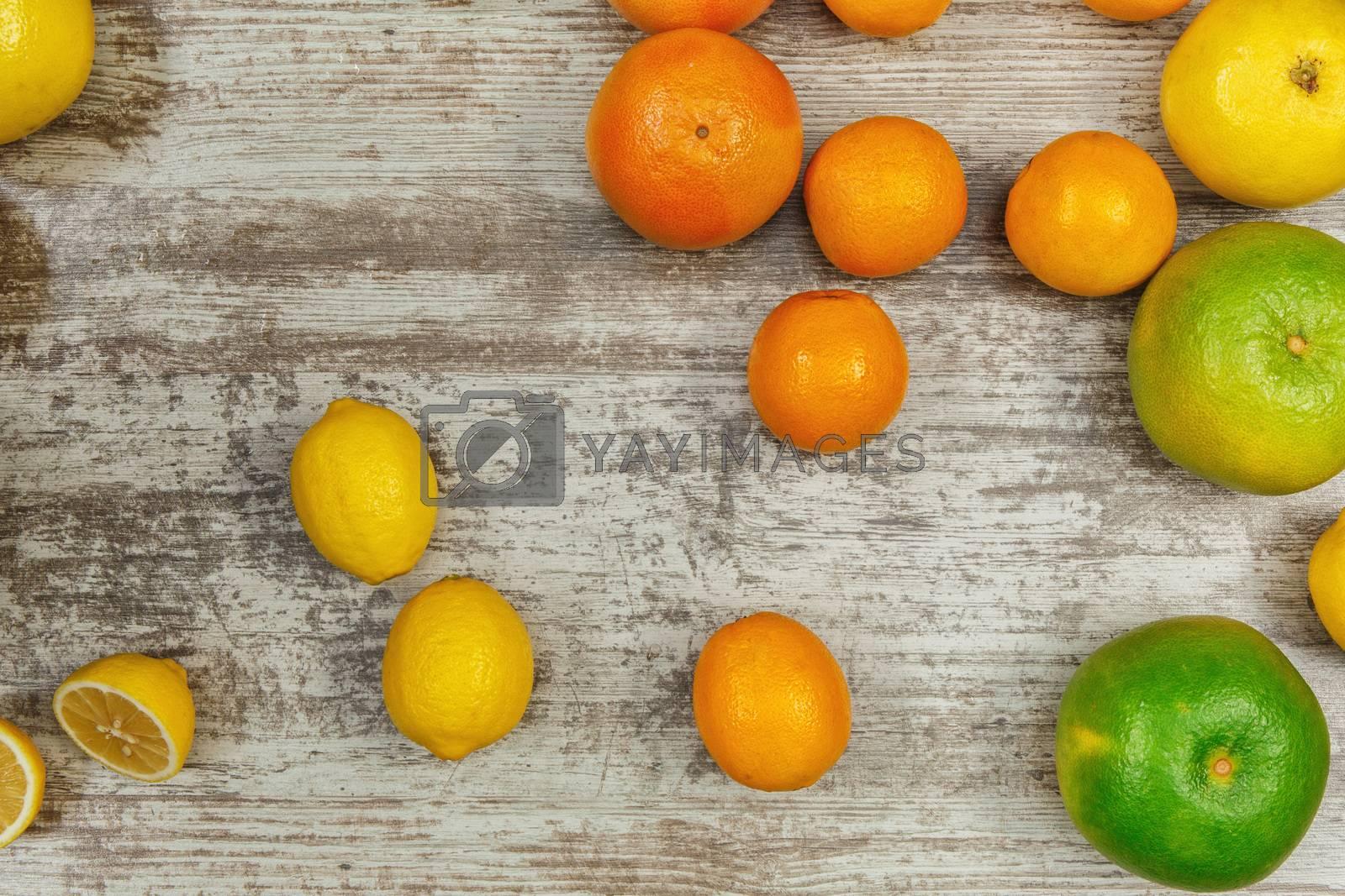 Background from citrus fruits - lemons oranges limes