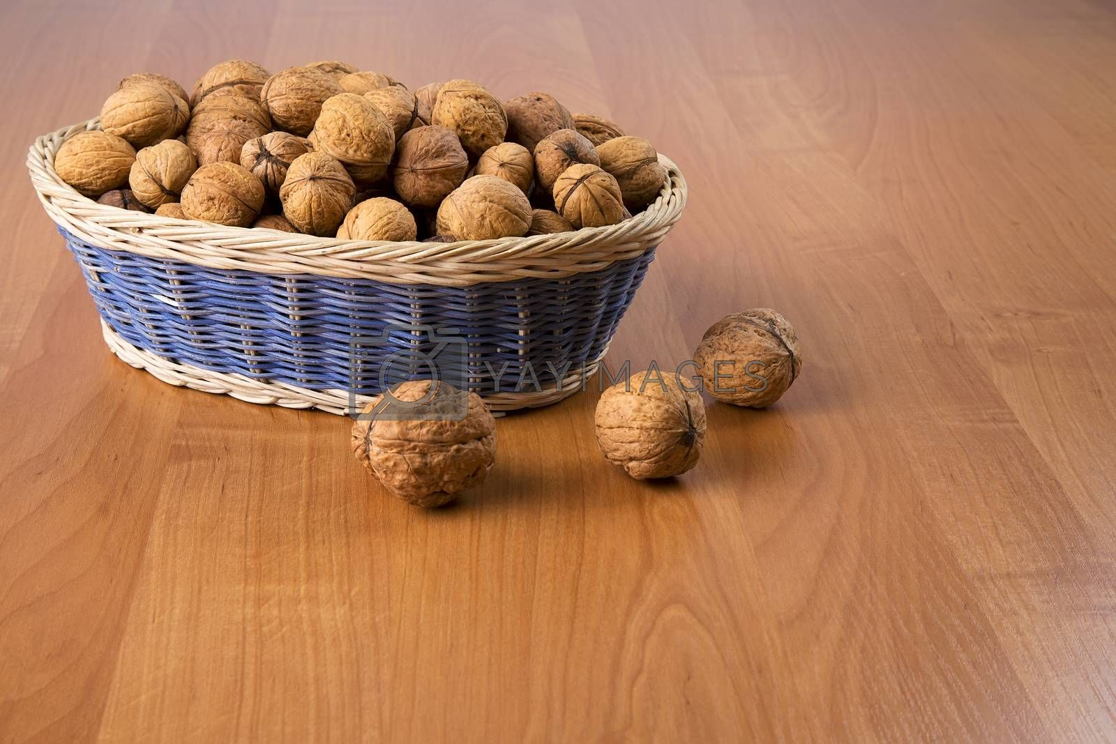 Nuts in a basket on a wooden background