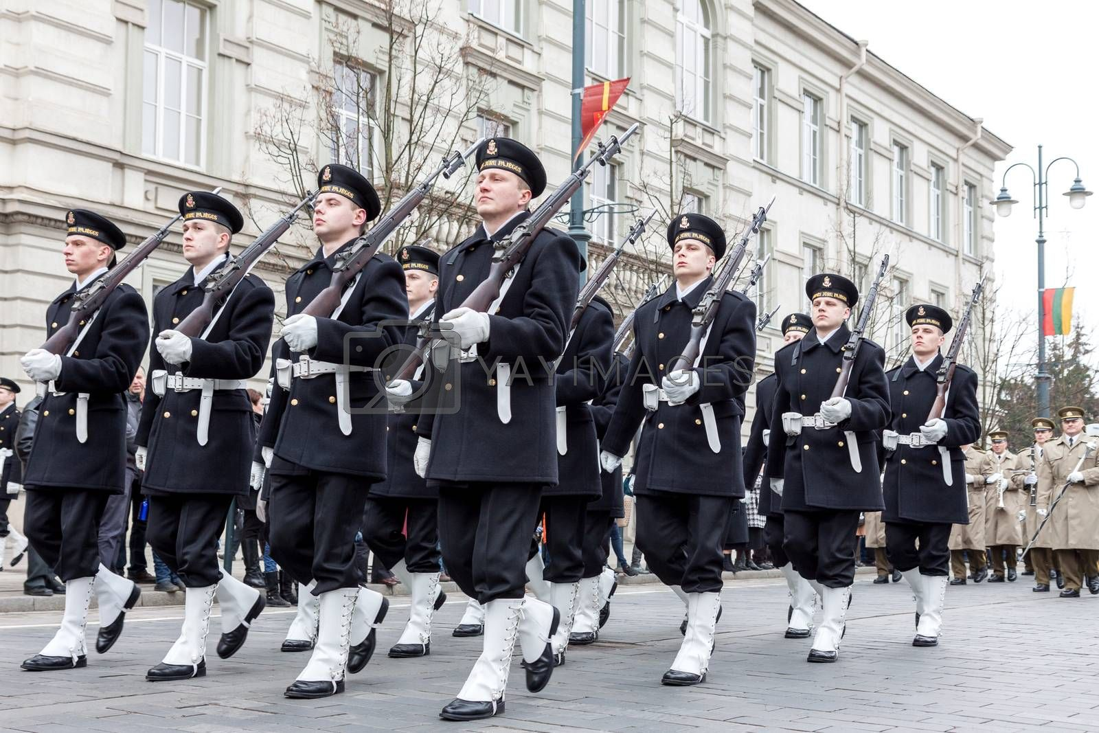 VILNIUS, LITHUANIA - MARCH 11, 2015: Lithuania Marine Corps marching at Independence Day Parade in Vilnius, capital of Lithuania. Corps wearing black-white dress uniforms and carrying rifles