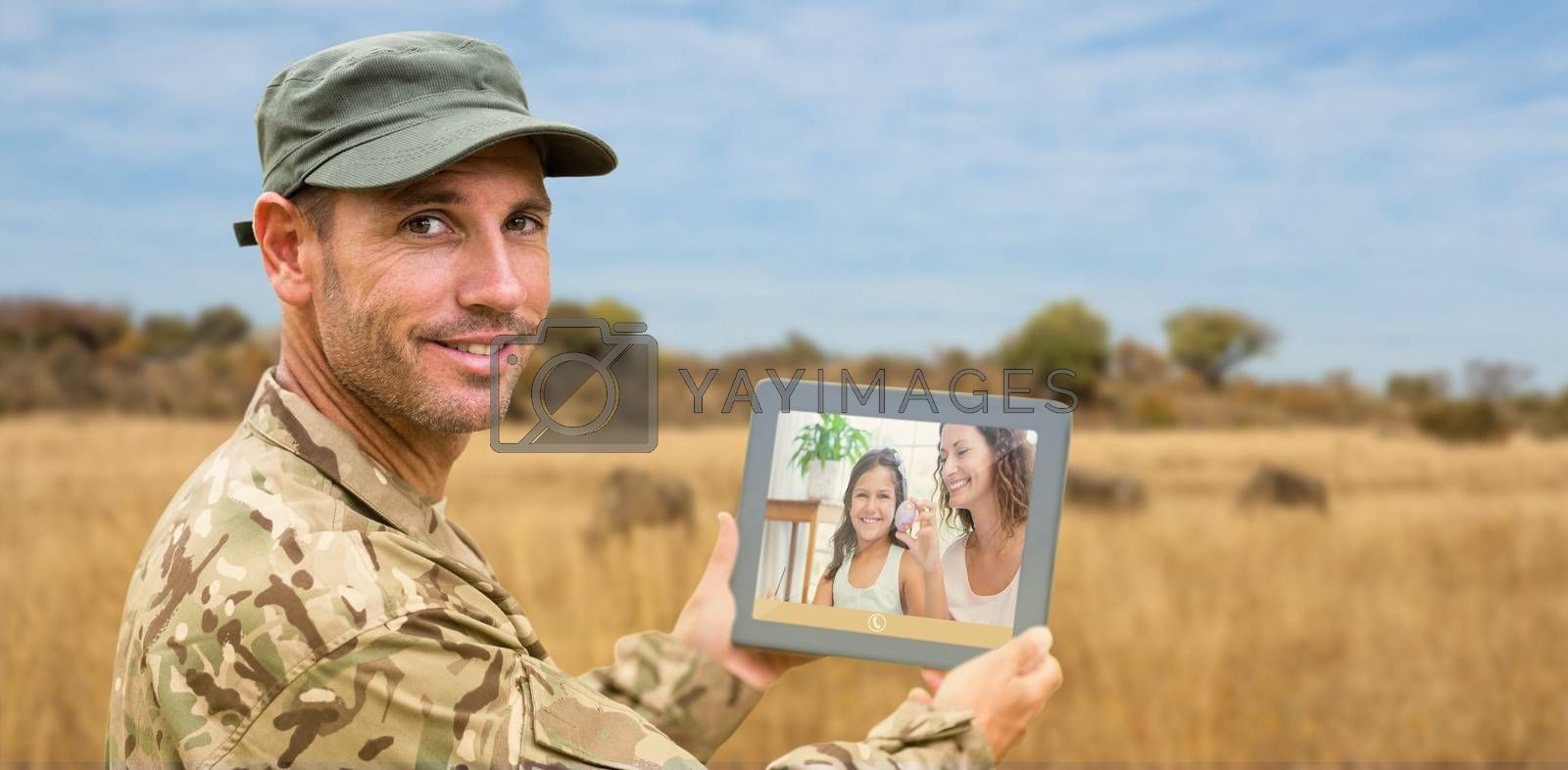 Composite image of soldier using tablet pc by Wavebreakmedia