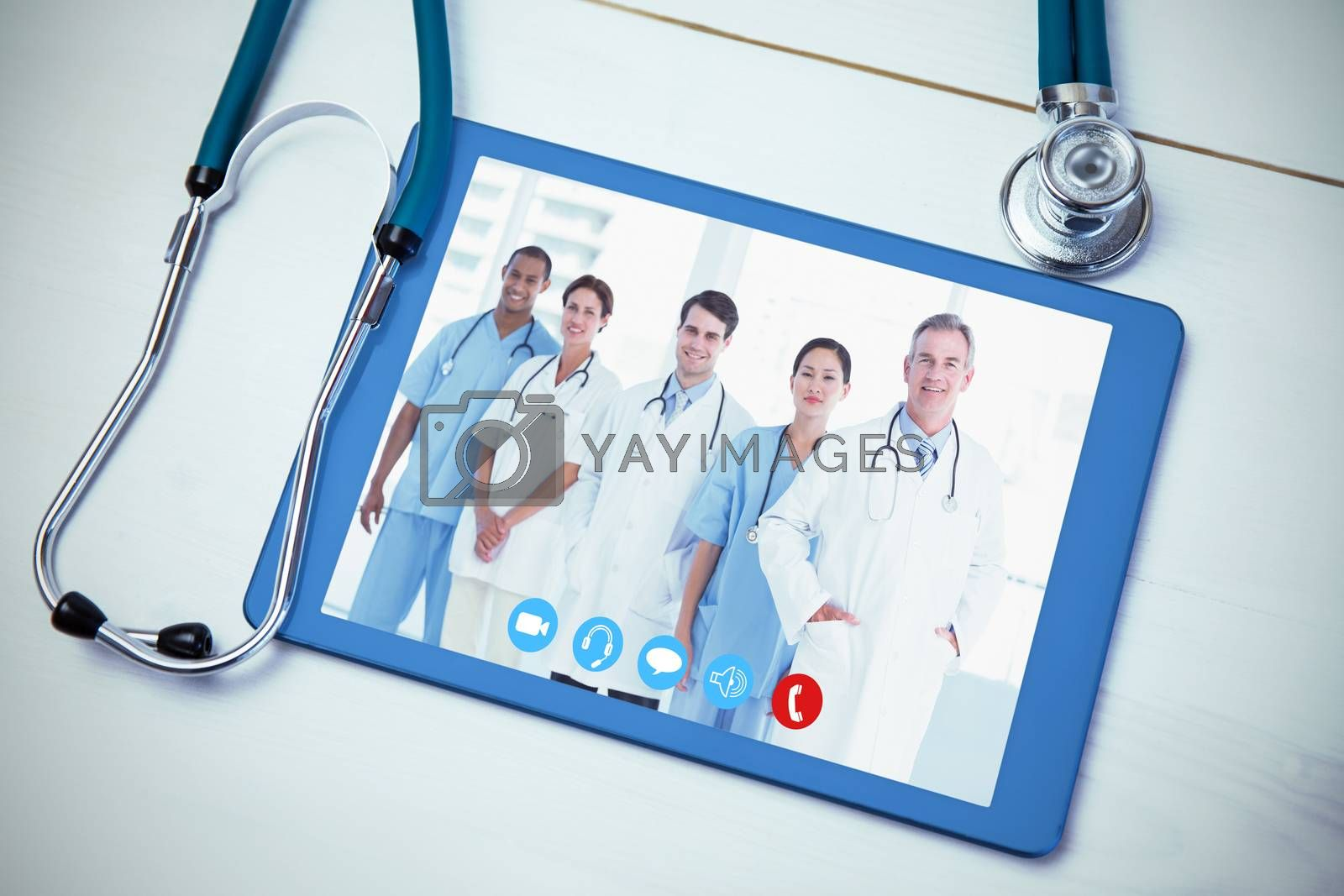 View of video chat app against tablet and stethoscope on desk