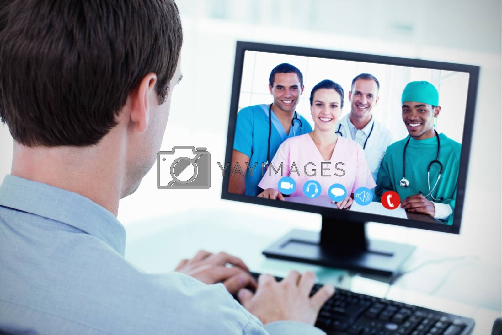 Portrait of a successful medical team at work against back view of a businessman working with a computer