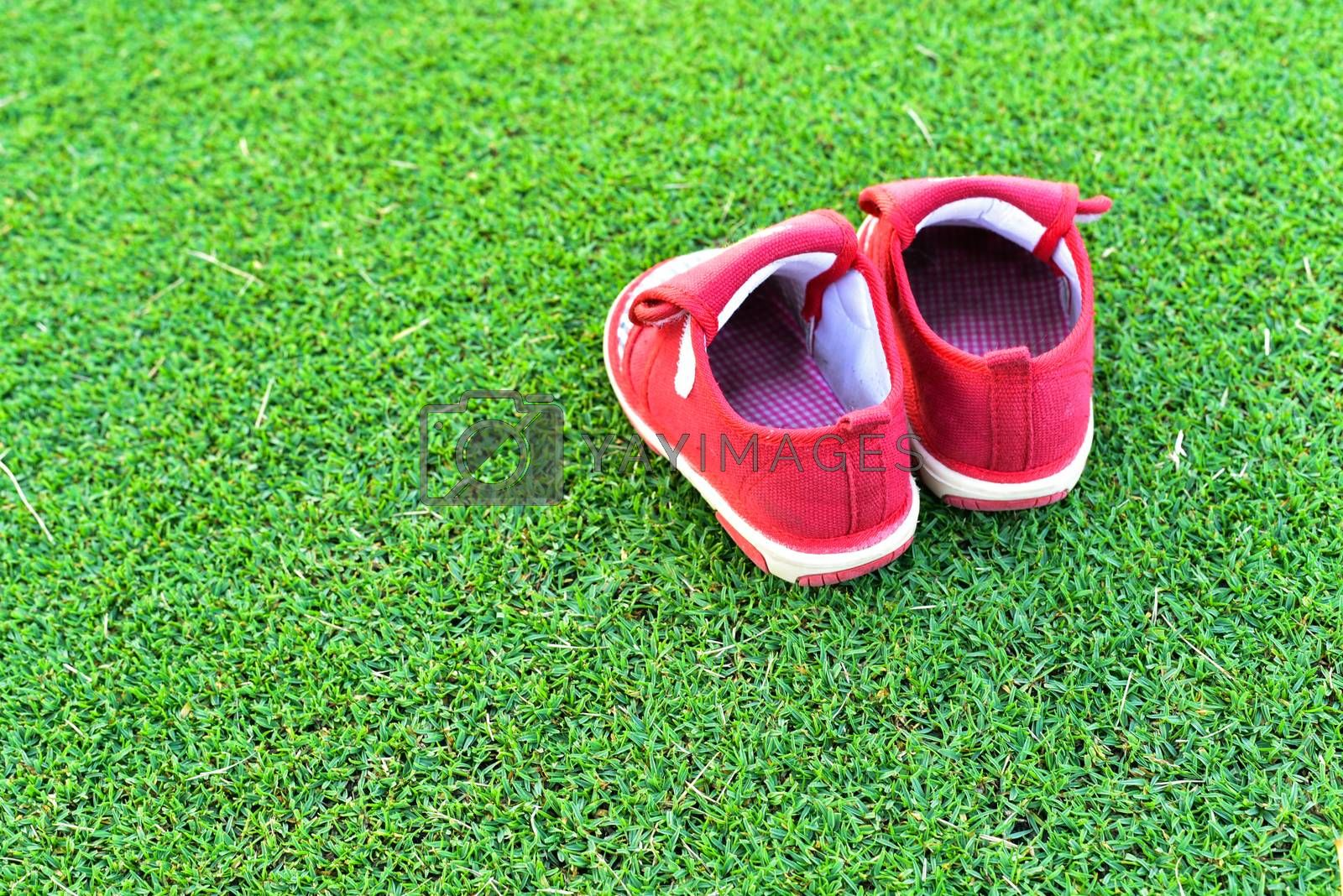 Little red shoes on grass