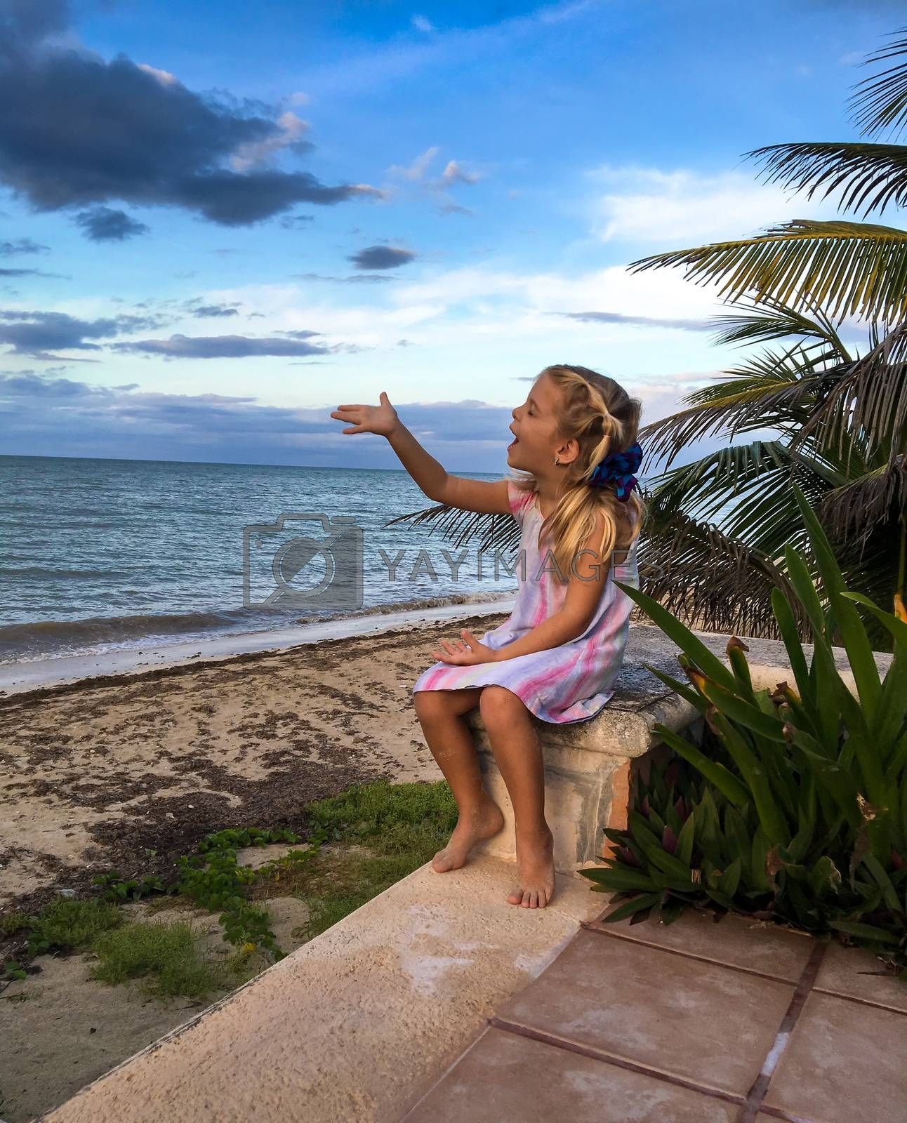 Little Girl playing at a yucatan peninsula beach