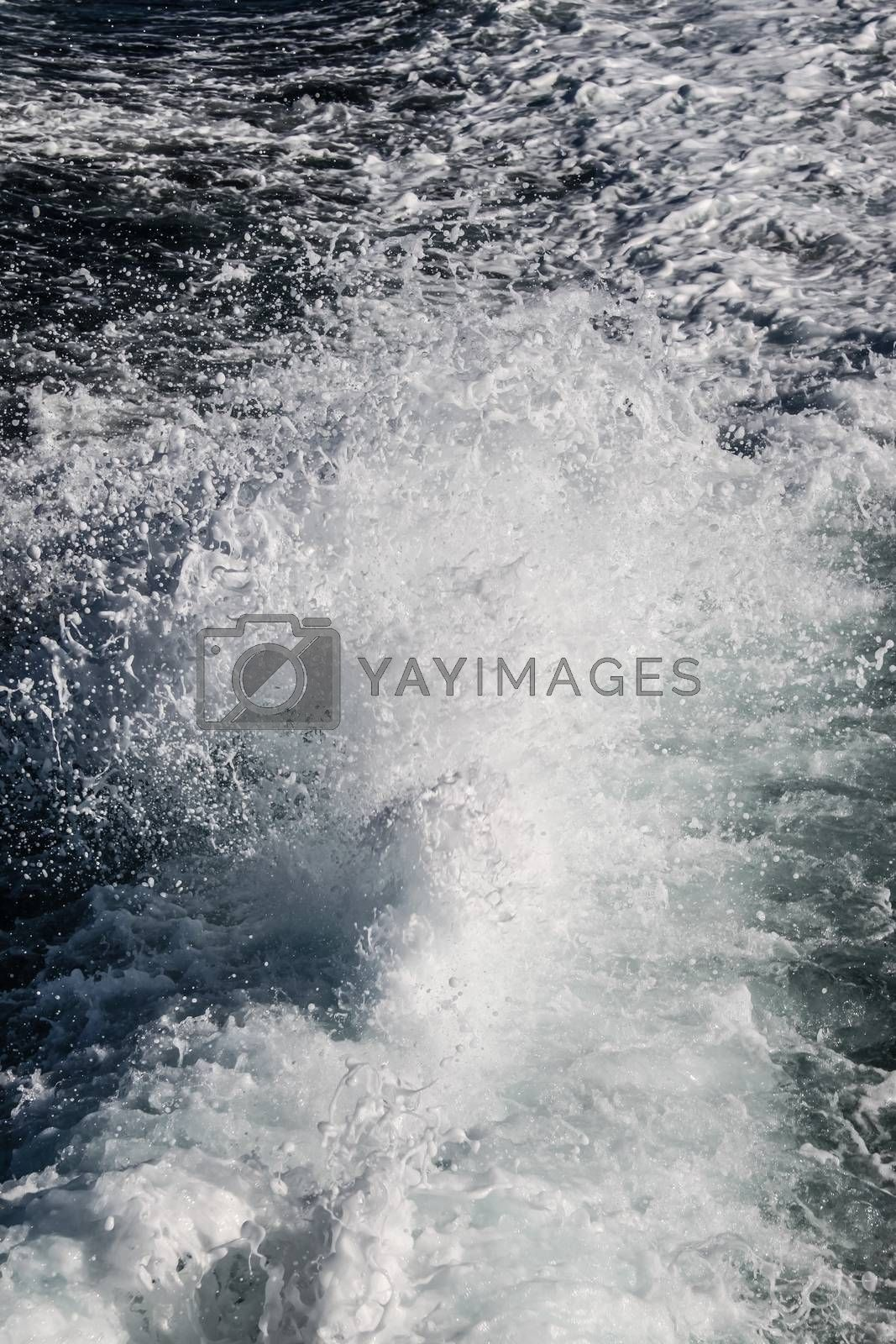 View of the white water from the rear of a ship