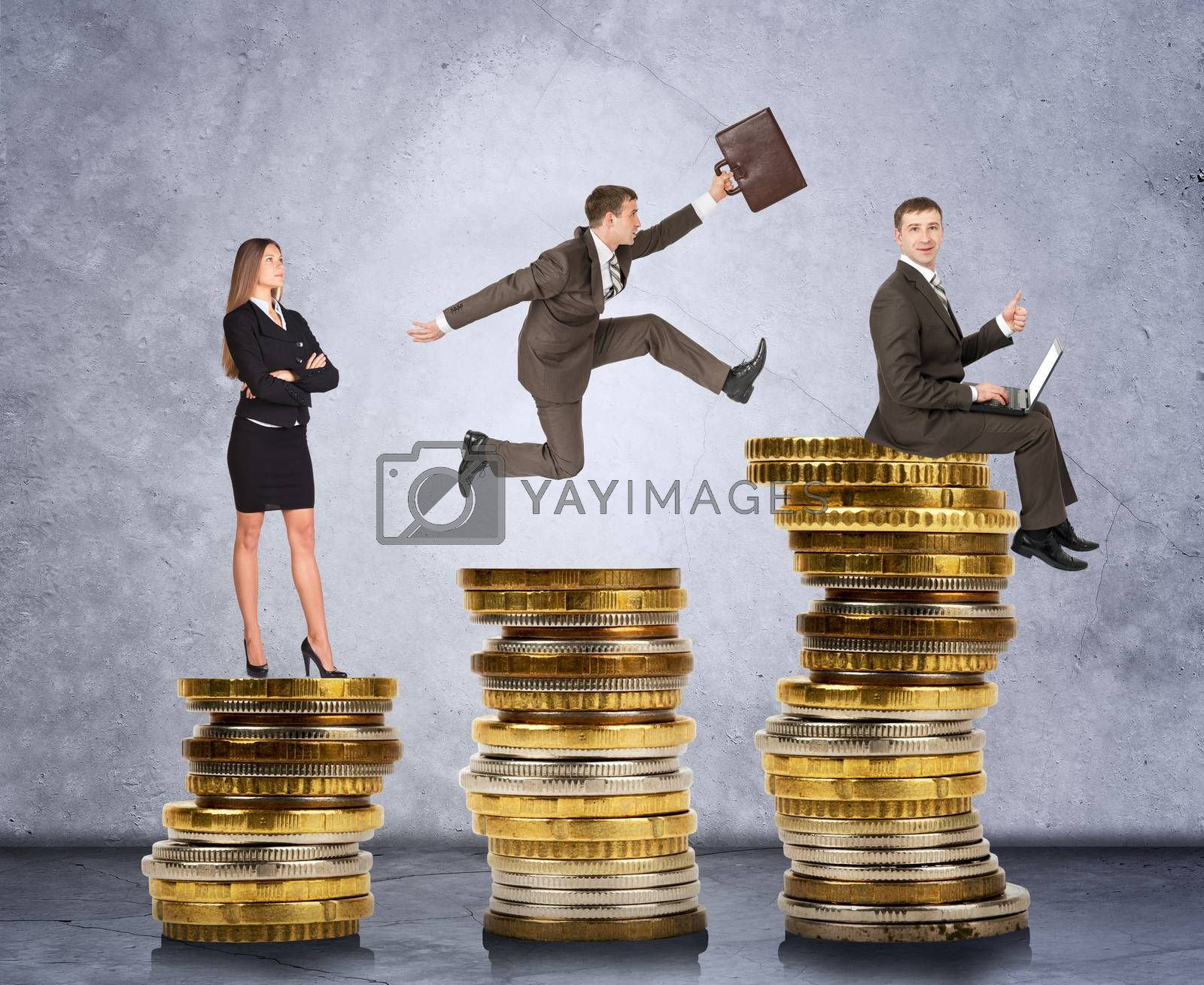 Business people on coins on grey wall background, business concept
