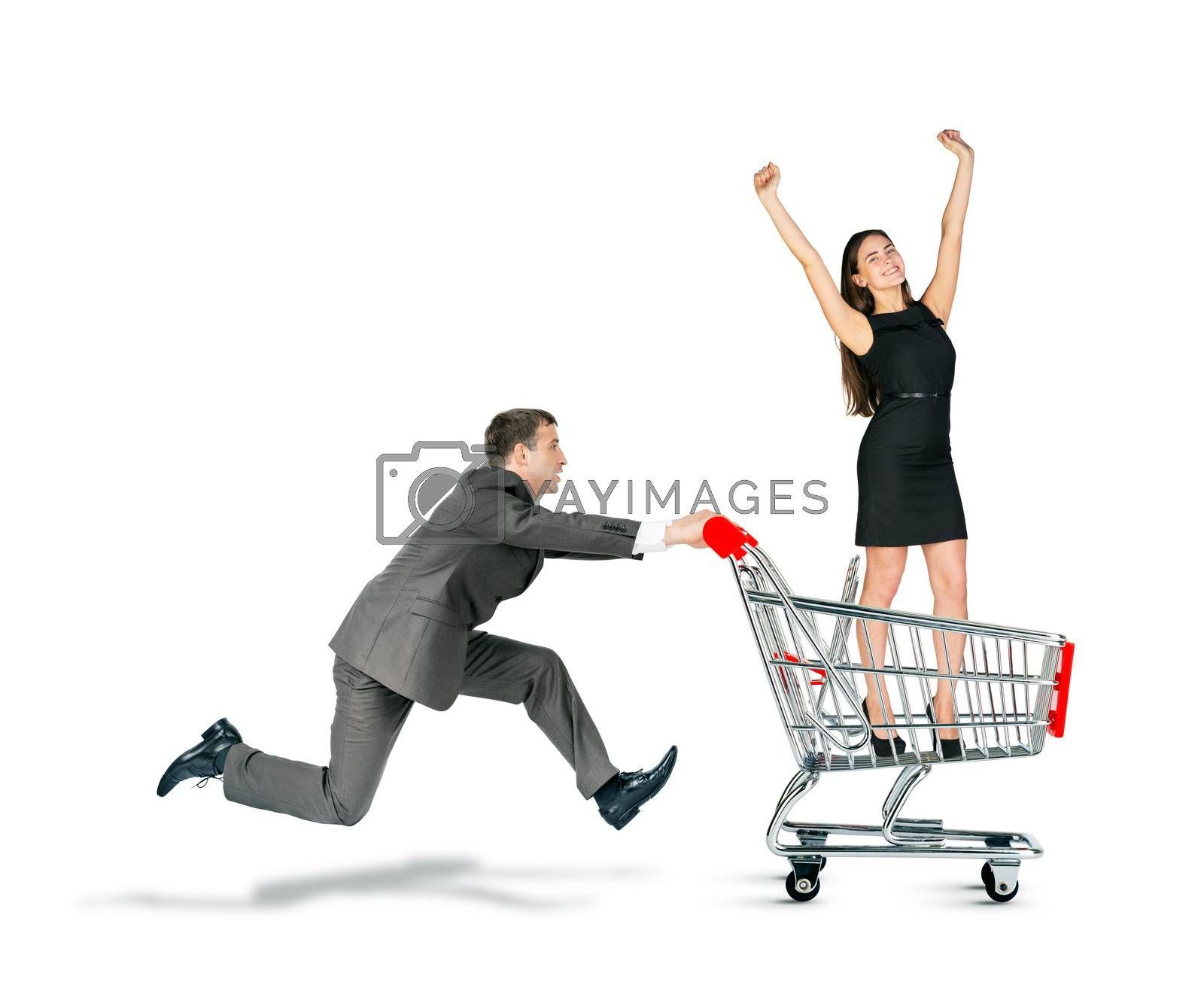 Businessman pushing shopping cart with business lady isolated on white background