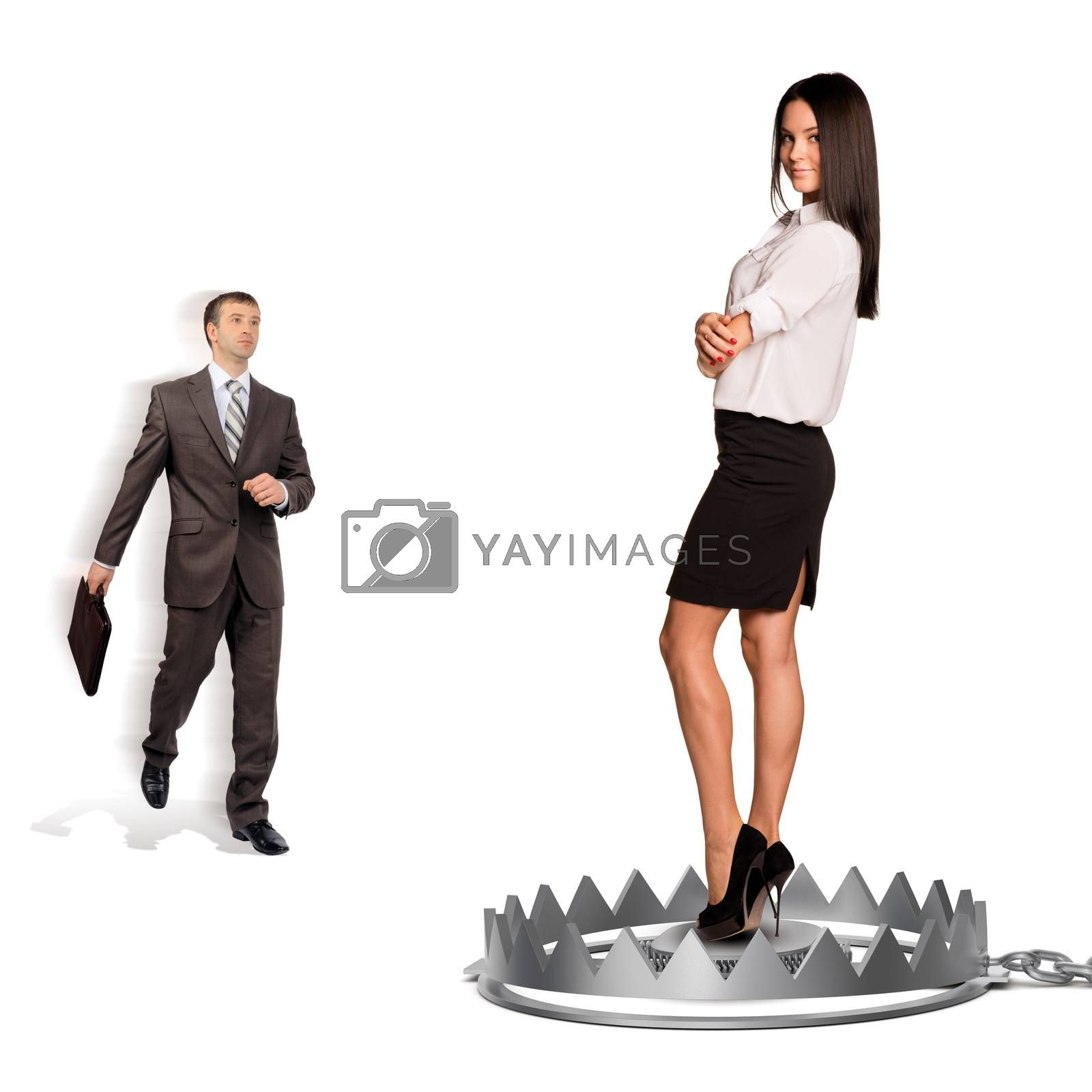 Businessman with woman in bear trap isolated on white background