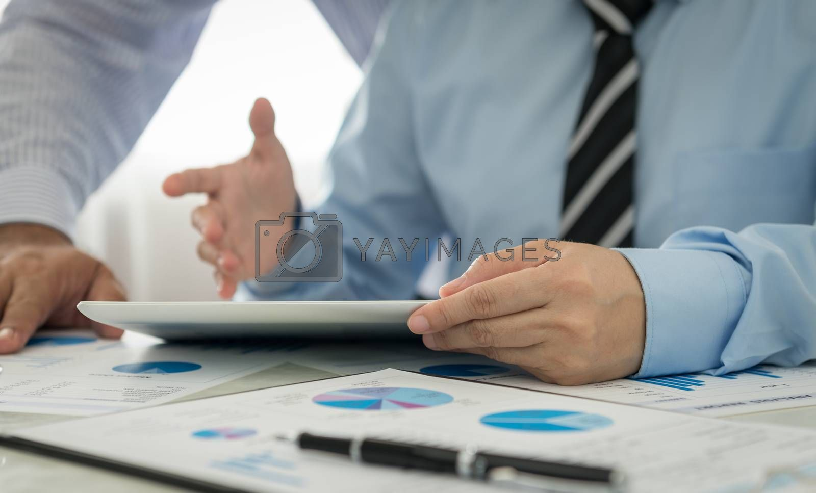 Businessman analyzing financial data of the company.