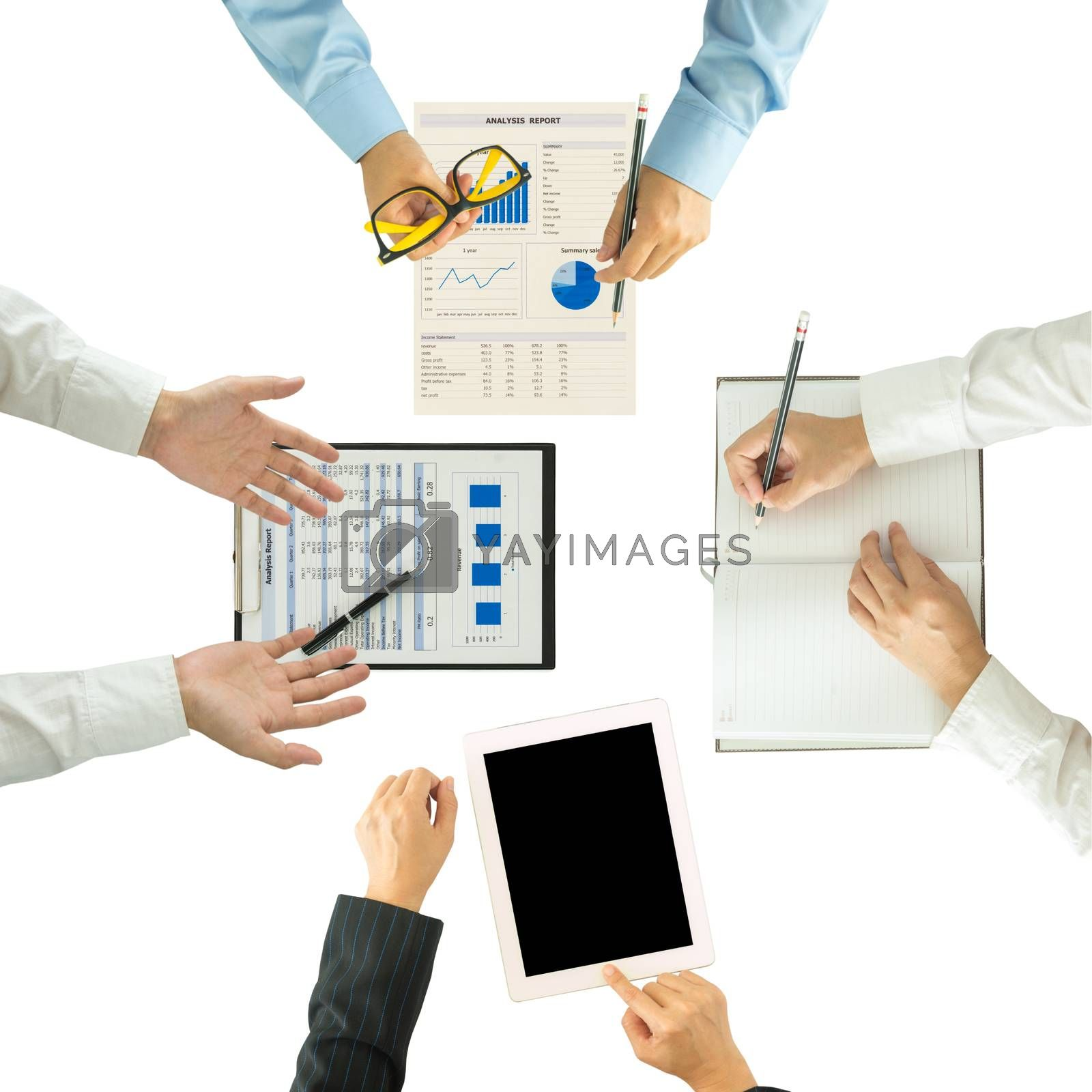 Top view of group of business people working on an office desk.