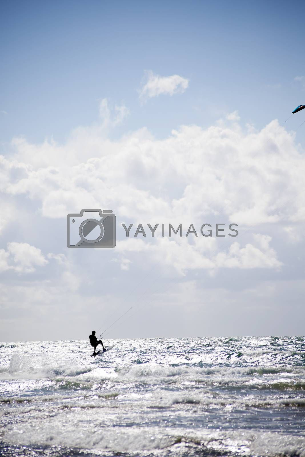 extreme kite surfer jumping waves at beach in ballybunion county kerry ireland on the wild atlantic way