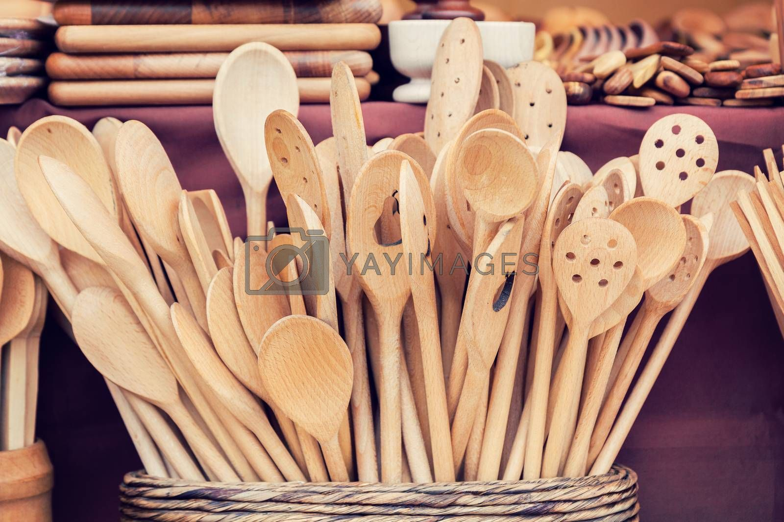 Handmade wooden kitchen utensils for sale at the market