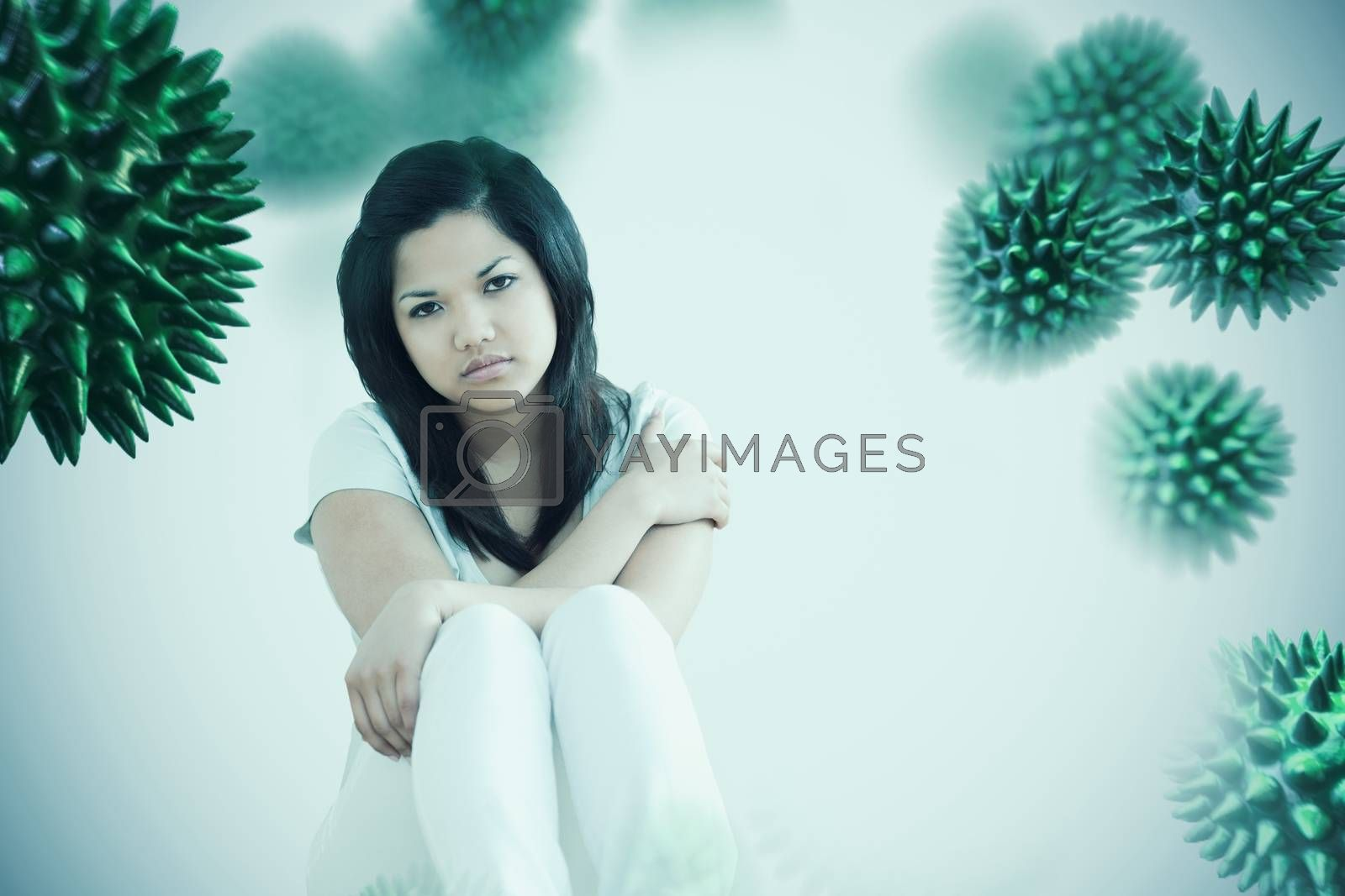 Barefoot woman sitting on the floor  against white background with vignette