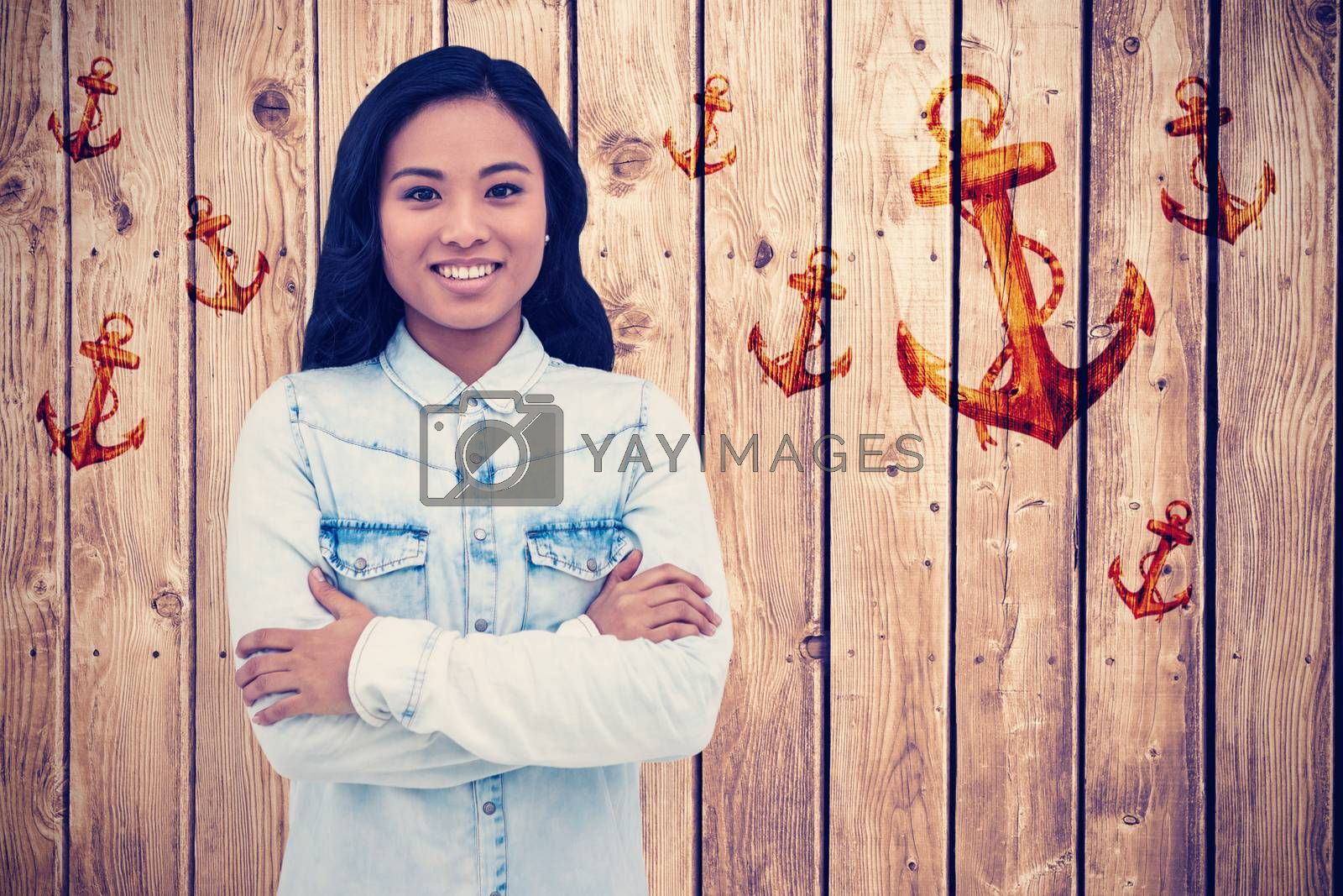 Asian woman with arms crossed smiling against white background with vignette