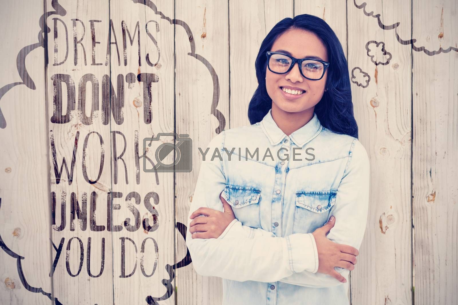 Composite image of asian woman with arms crossed smiling in front of wooden background
