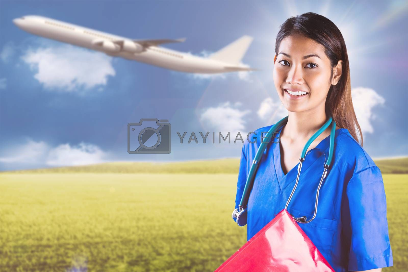 Composite image of asian nurse with stethoscope looking at the camera by Wavebreakmedia
