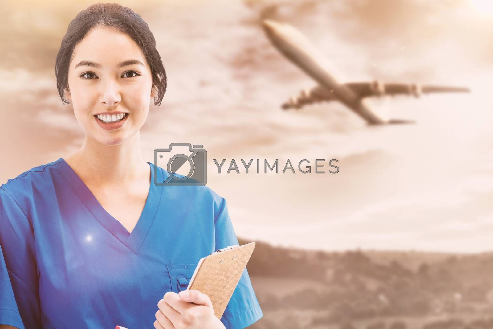 Asian nurse with stethoscope looking at the camera against a white screen against sunny landscape painted on wall