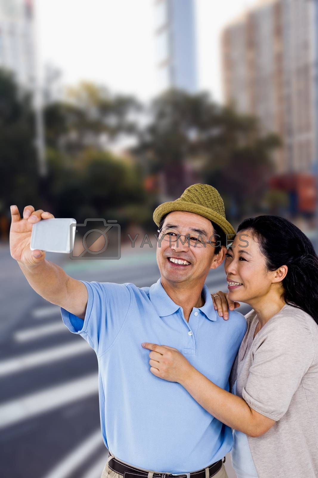 Man and woman taking a picture against new york street