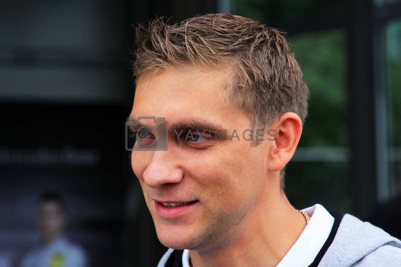 """Moscow, Russia - 21 July, 2013: Russia racing driver, pilot of Renault F1 Team Vitaly Petrov in a grand car show called """"Moscow City Racing"""" in the center of Moscow, Russia."""