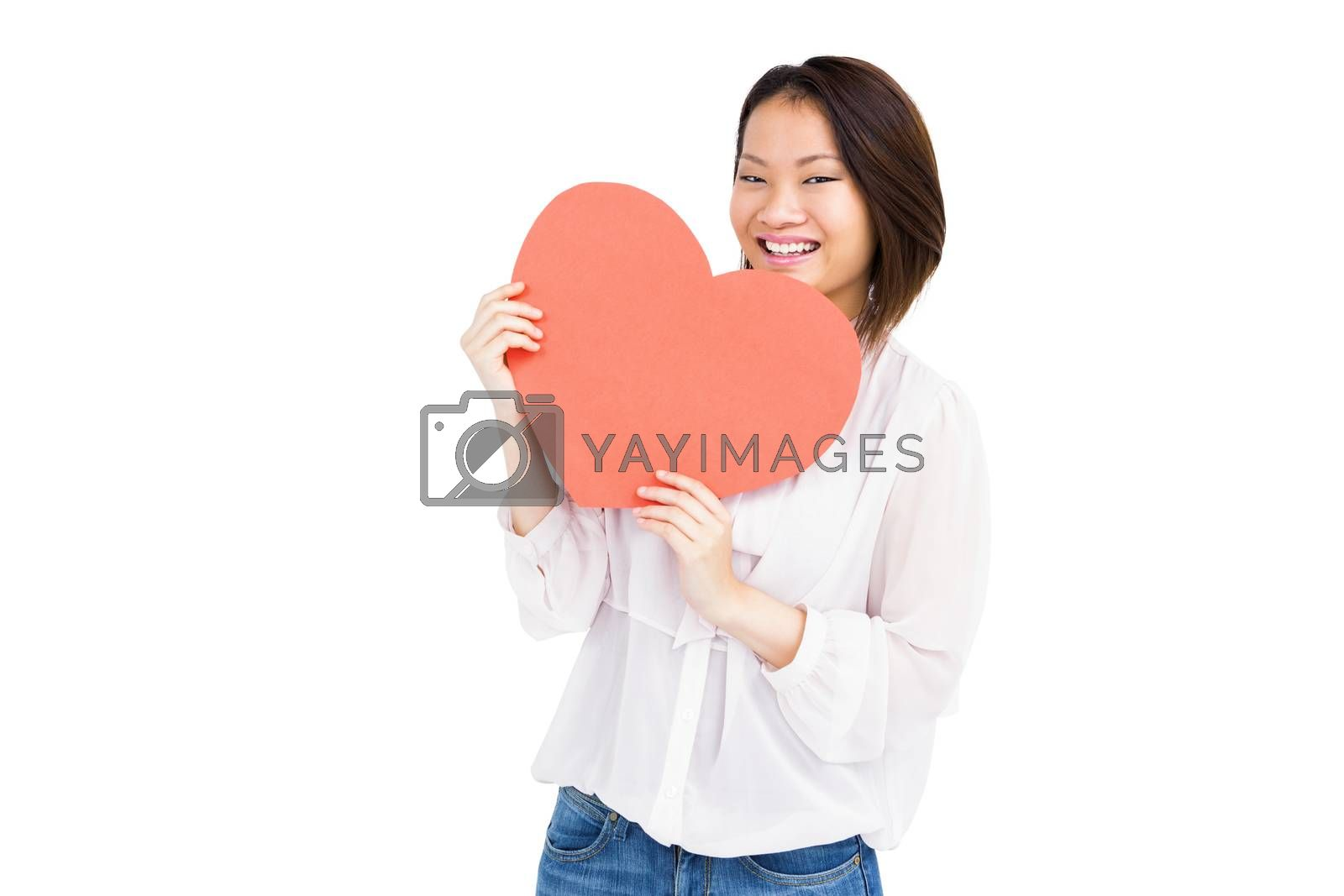 Portrait of woman holding heart shape on white background