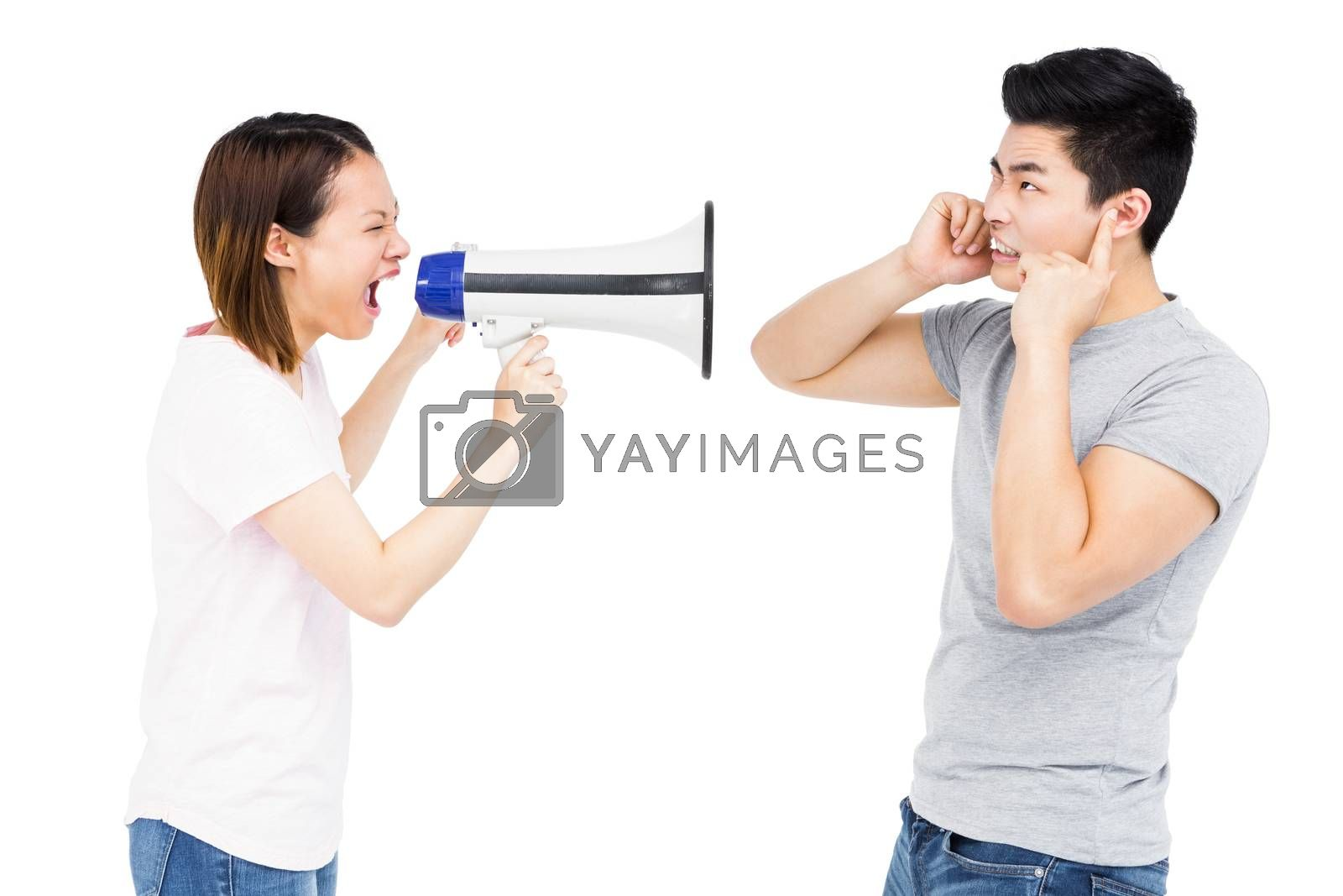 Angry woman shouting at young man on horn loudspeaker on white background