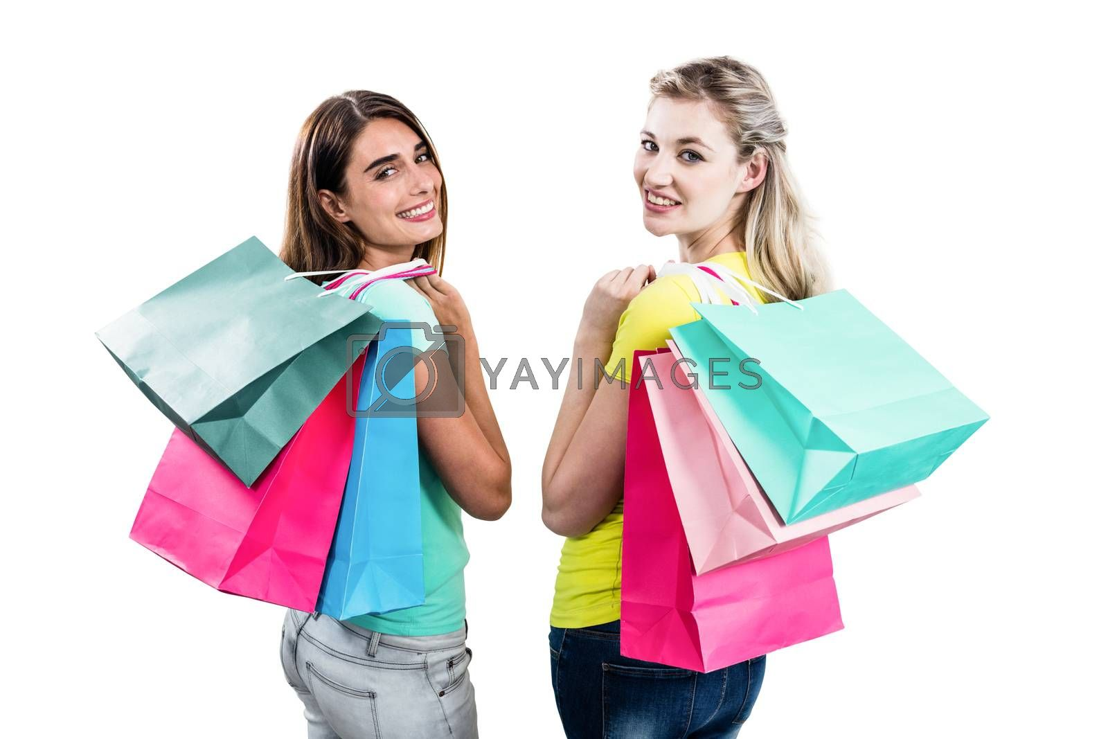 Portrait of friends holding shopping bags on white background