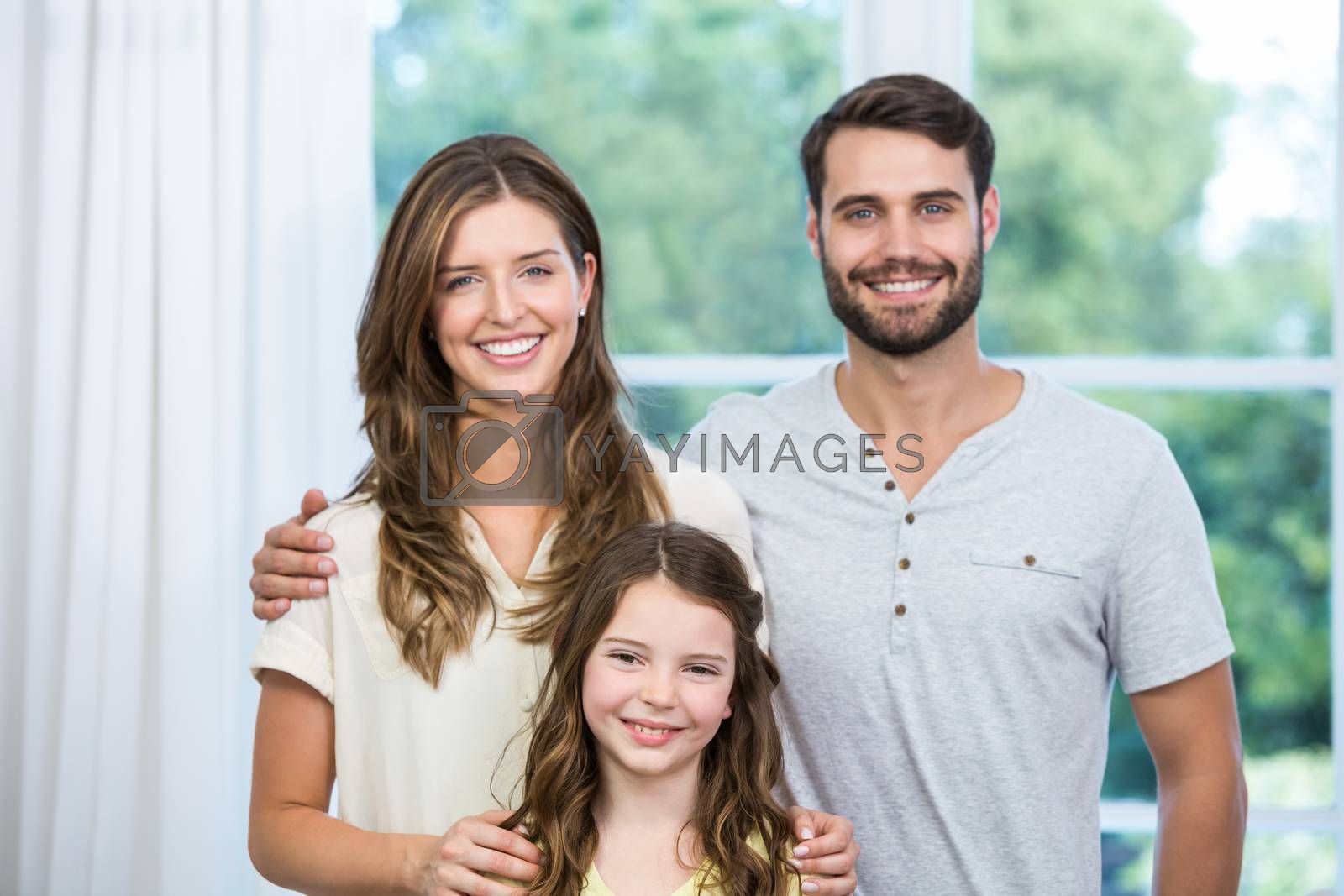 Portrait of smiling family standing at home
