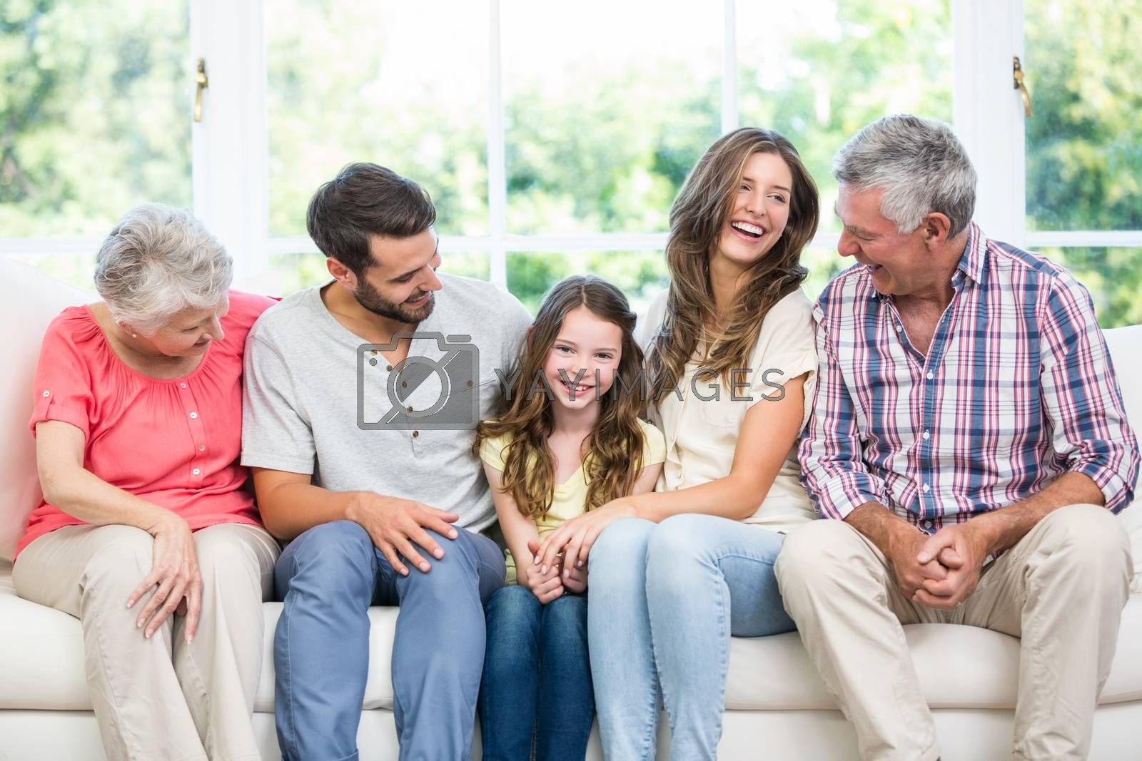 Family sitting on sofa in living room by Wavebreakmedia