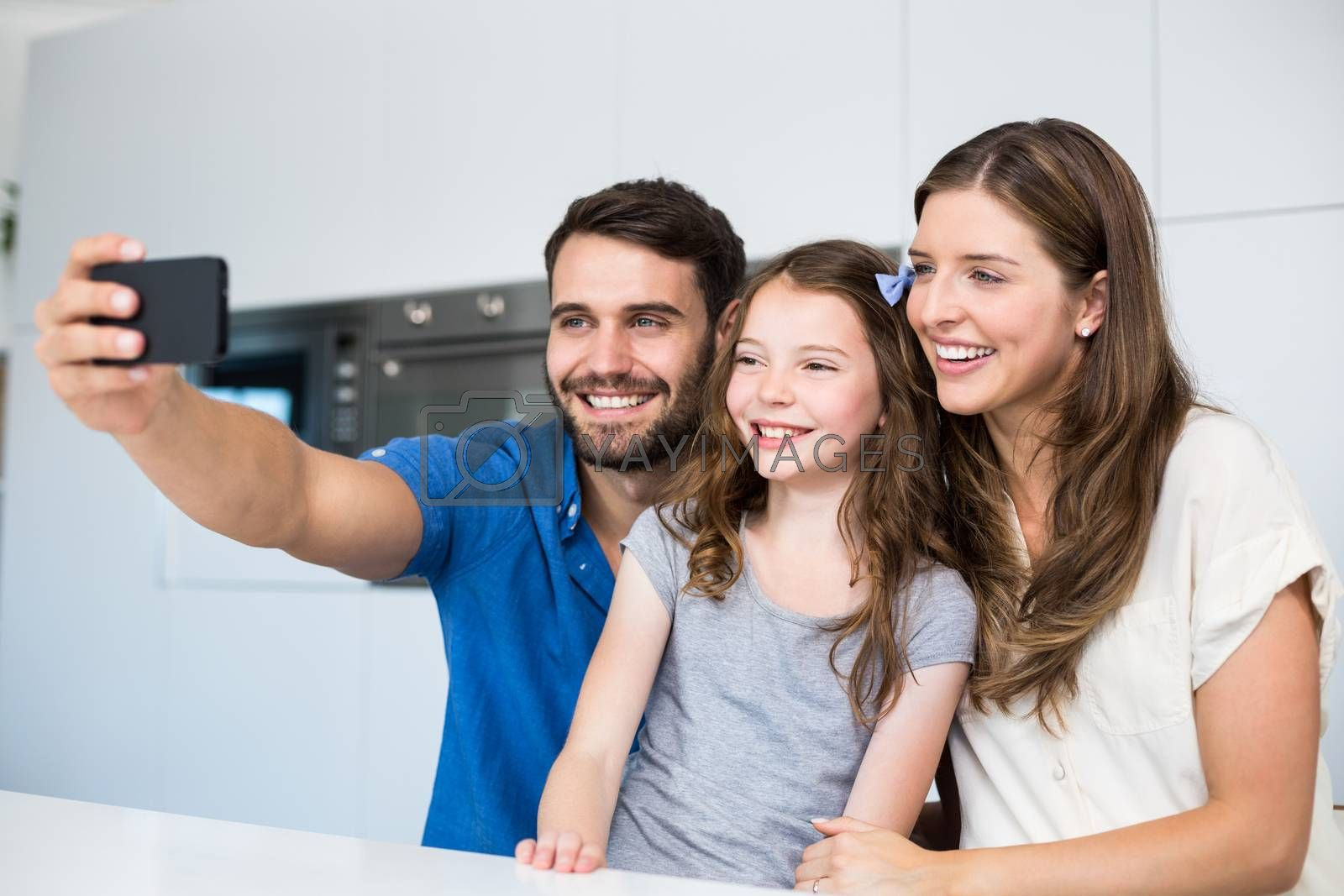 Happy family clicking selfie at home