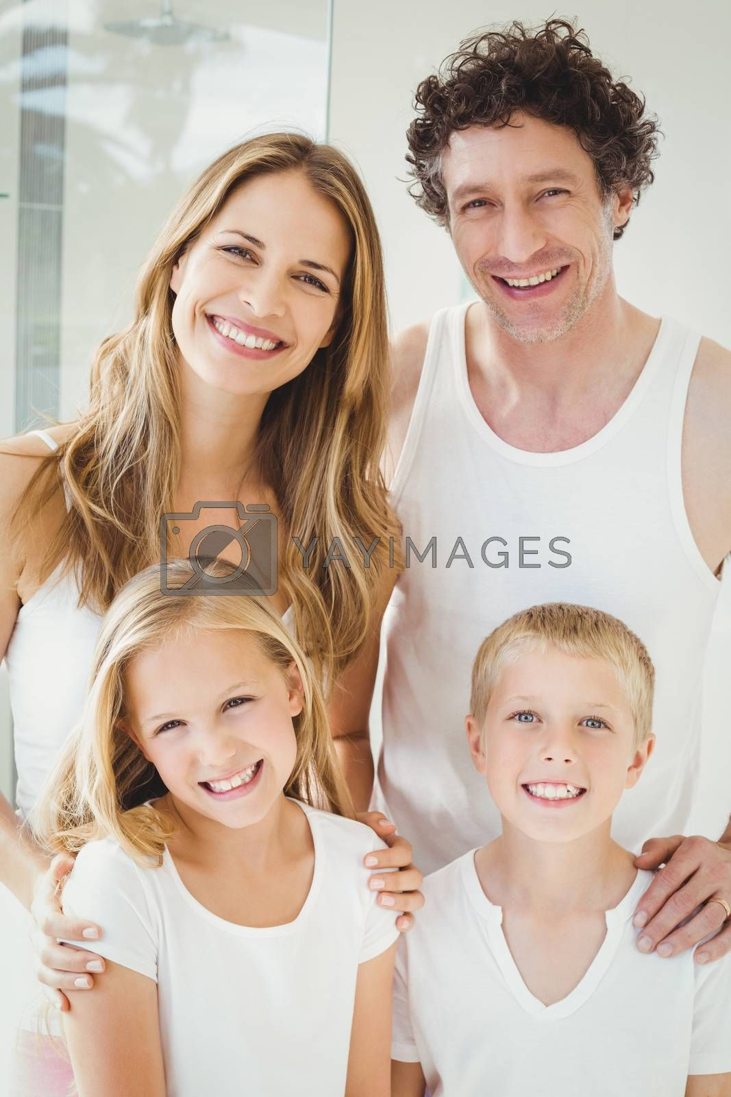 Portrait of smiling happy family standing at home