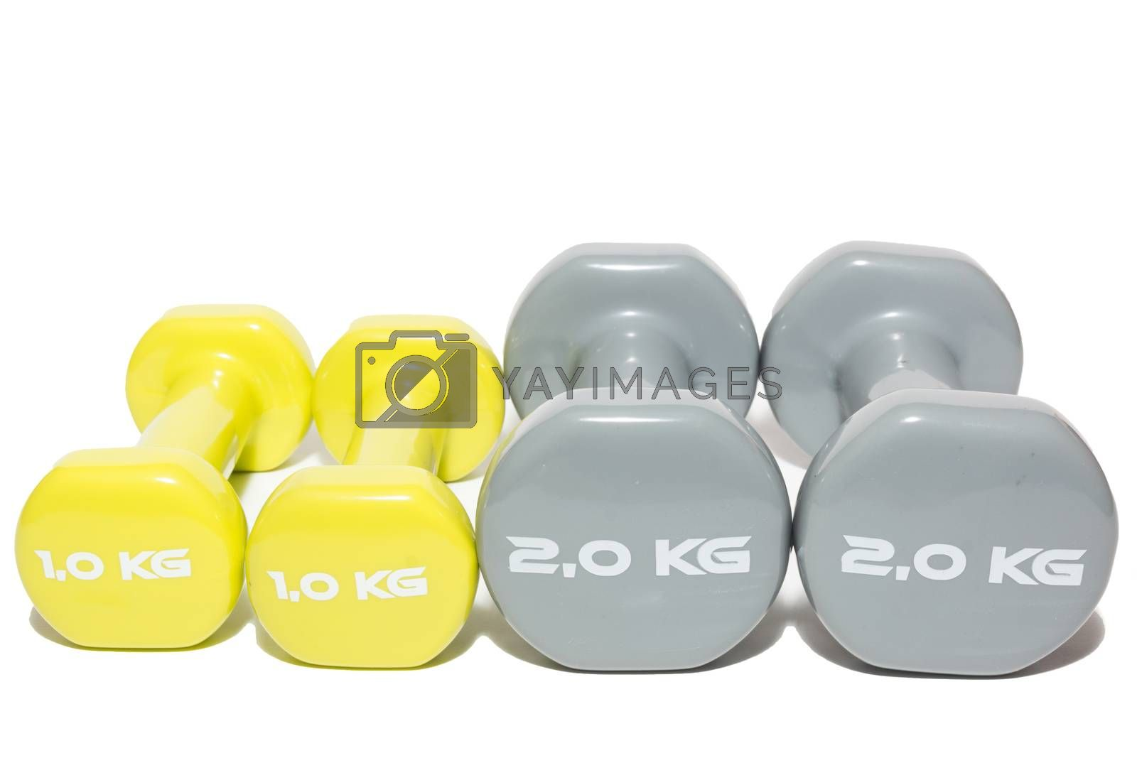 Royalty free image of dumbbell on a white background by AlexBush