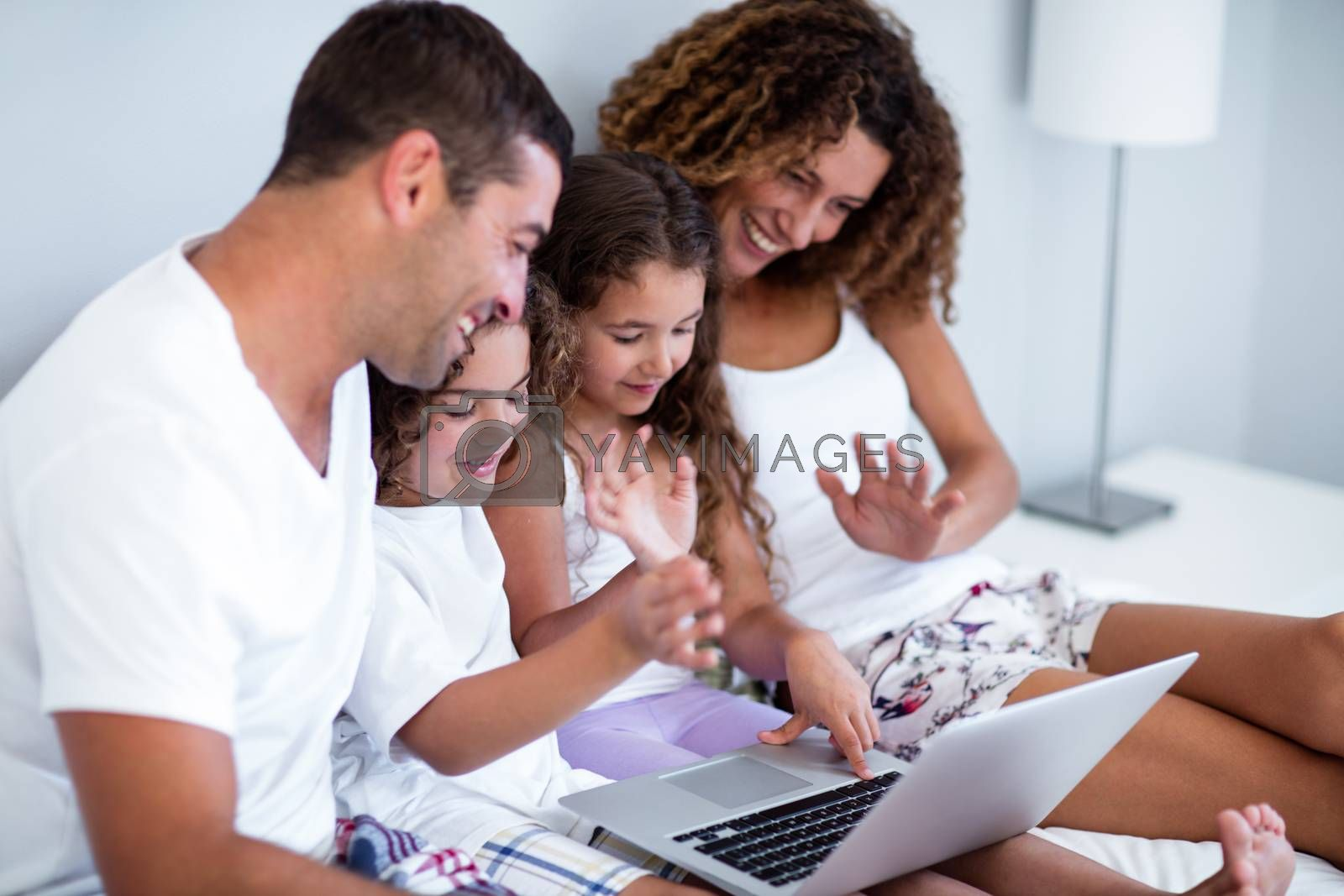 Family having video chat on laptop at home