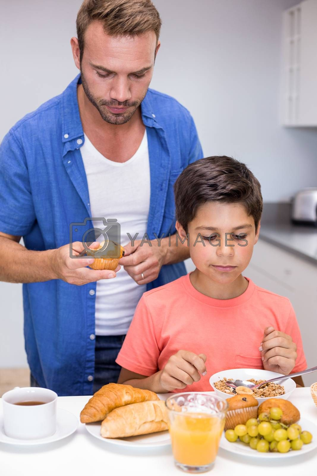 Father and son having breakfast in the morning