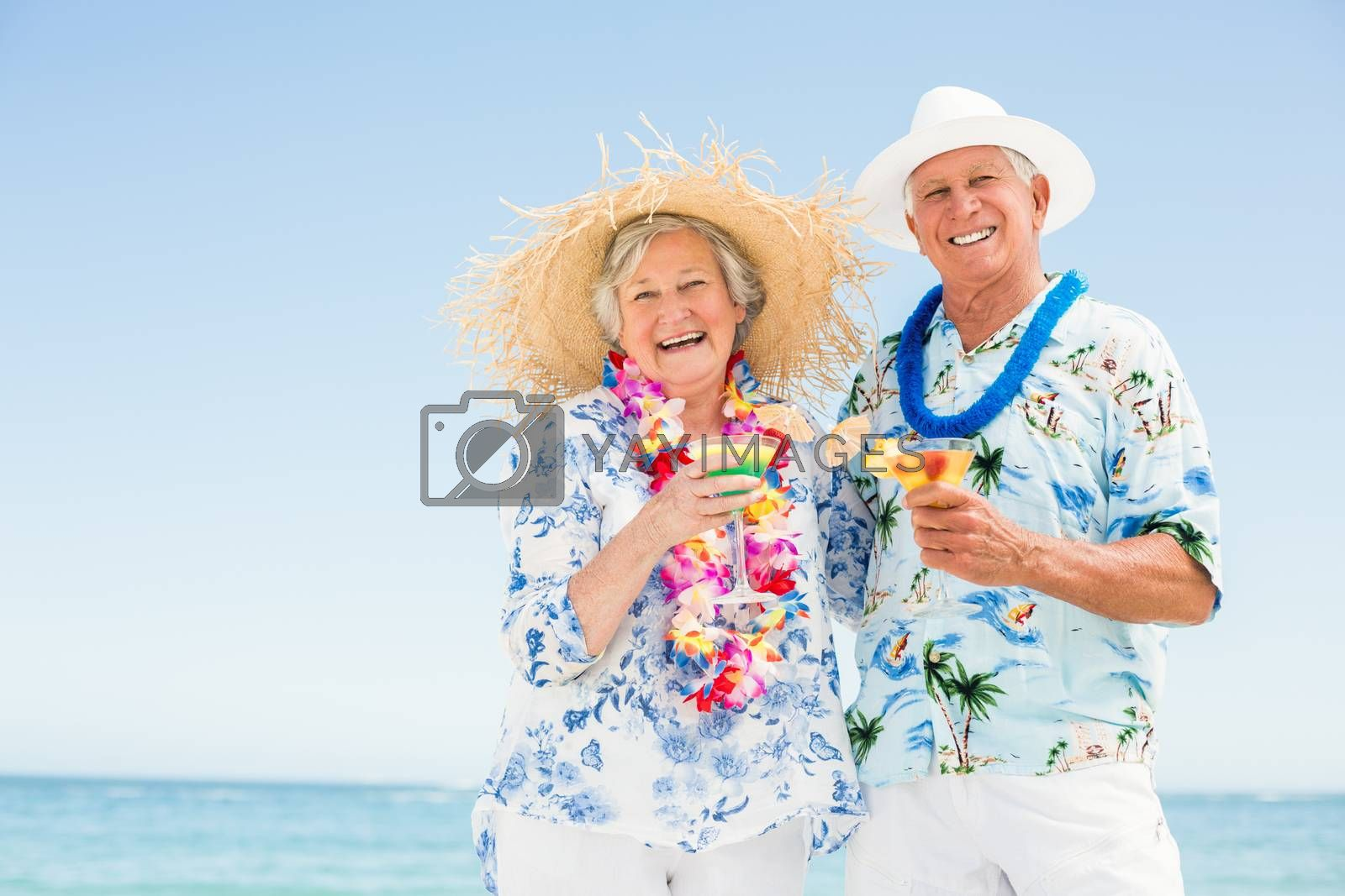Senior couple drinking cocktails on a sunny day