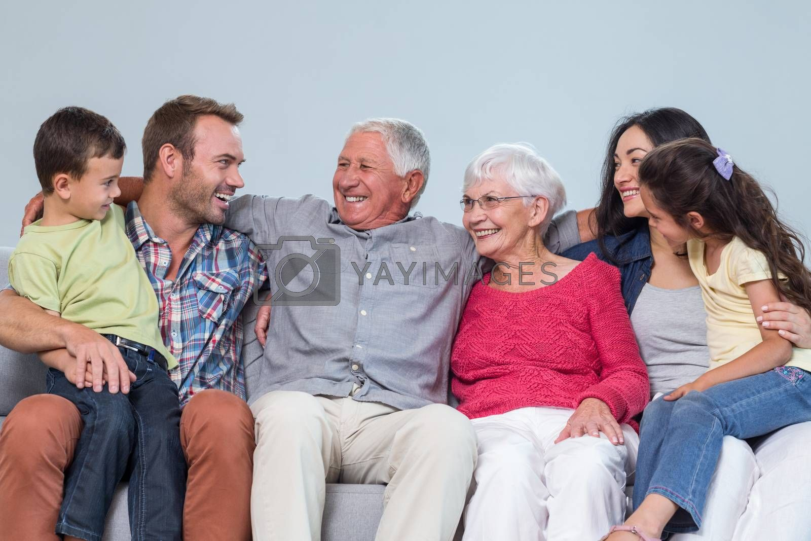 Family sitting on sofa and smiling in living room