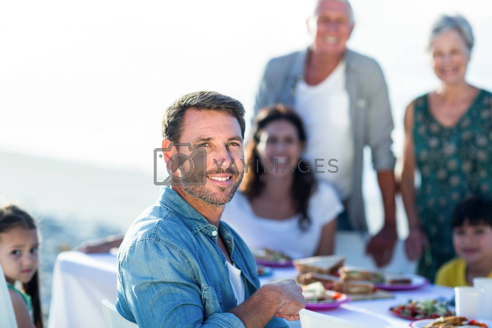 Royalty free image of Happy family having a picnic at the beach by Wavebreakmedia